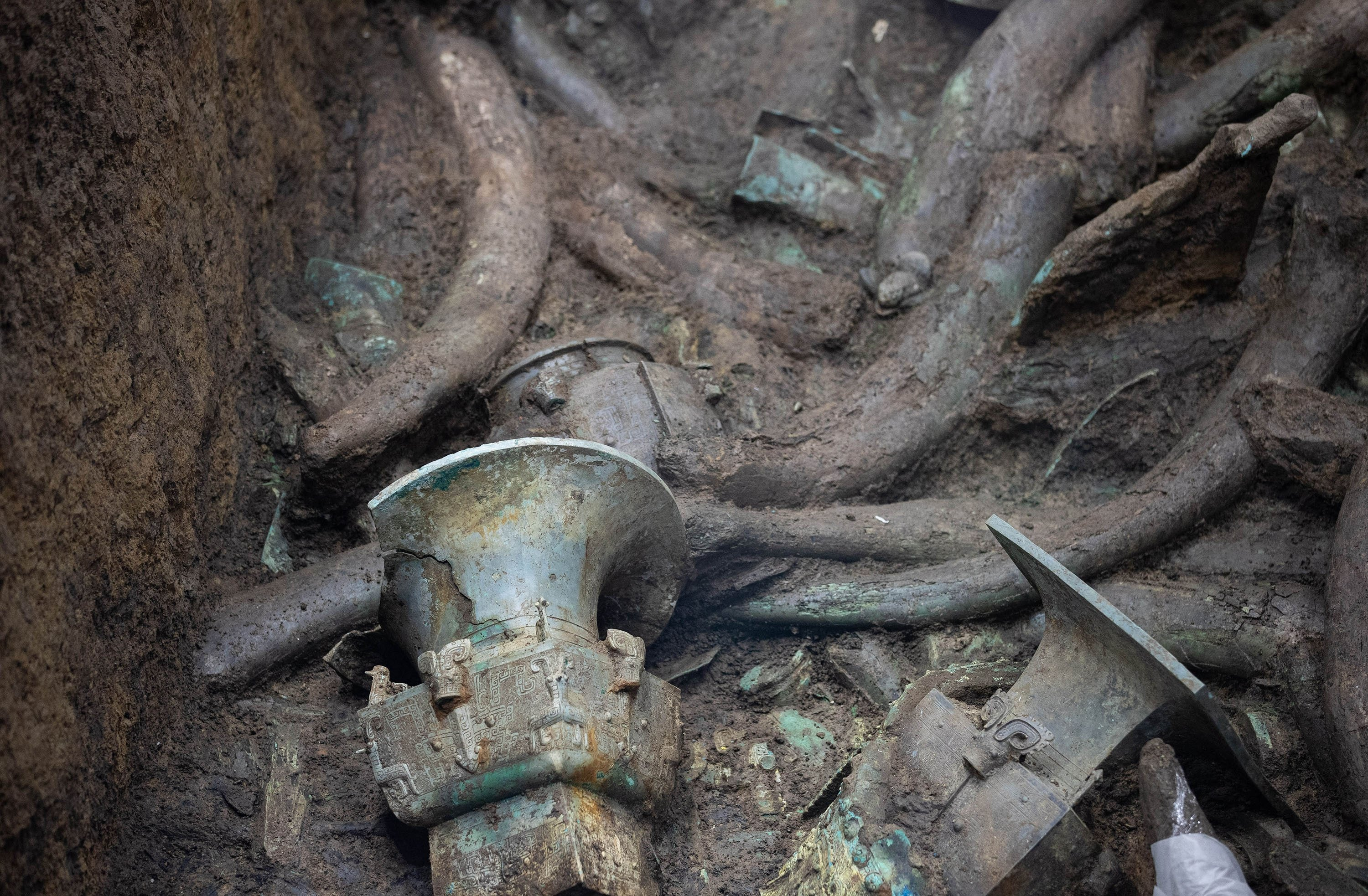 Cultural relics are unearthed at the No. 3 sacrificial pit of the Sanxingdui Ruins site in Deyang, Sichuan province, China, March 20, 2021. (Getty Images)