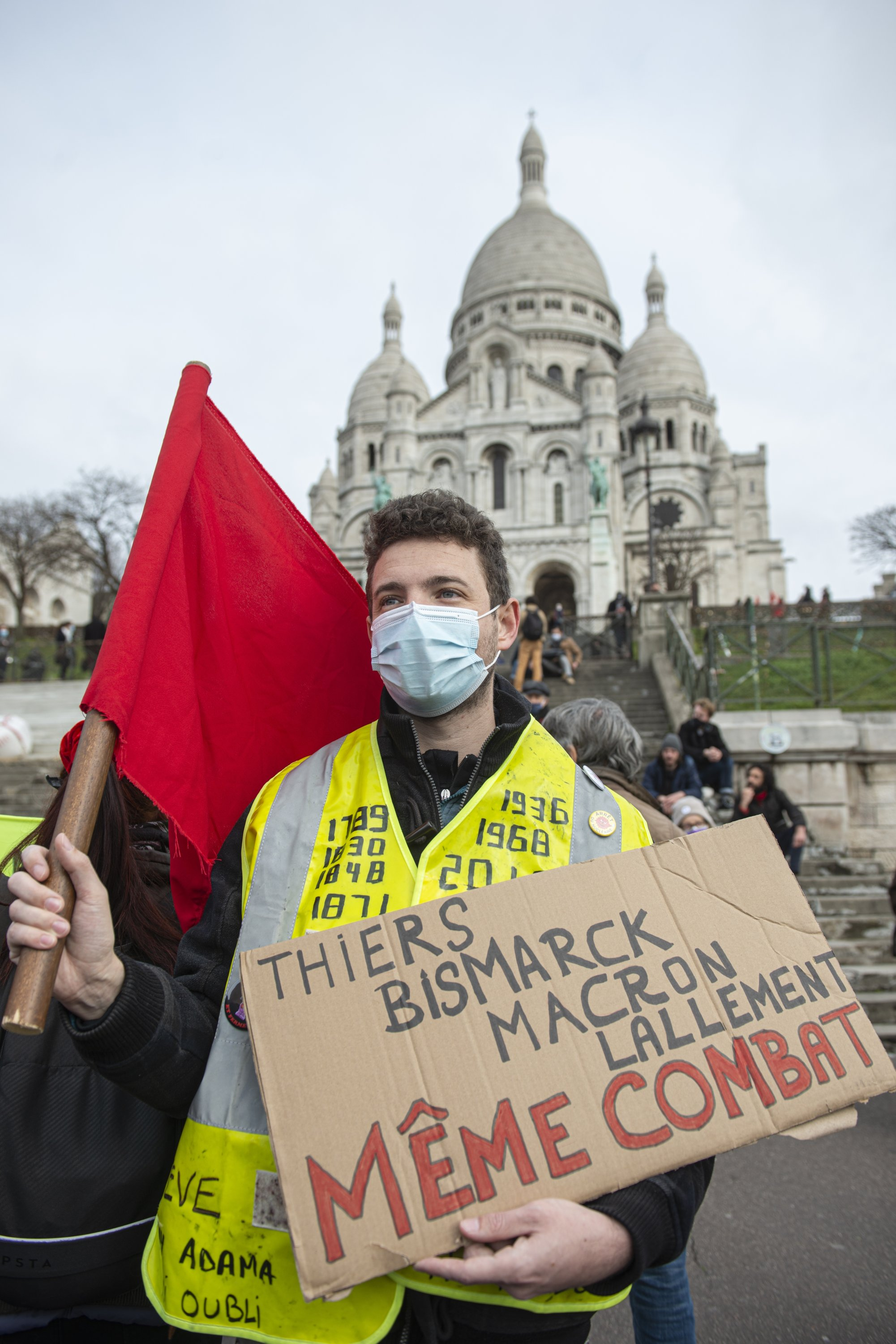 A commemoration of the 150th anniversary of the Paris Commune, in front of the Sacre-Coeur Basilica, in Montmartre, Paris, France, March 18, 2021. The placard reads: (French PM Adolphe) Thiers, (Prussian Chancellor Otto von) Bismarck, (incumbent French President Emmanuel) Macron, (Paris police chief Didier) Lallement, same fight. (Photo: Joao Luiz Bulcao/Hans Lucas via Reuters)