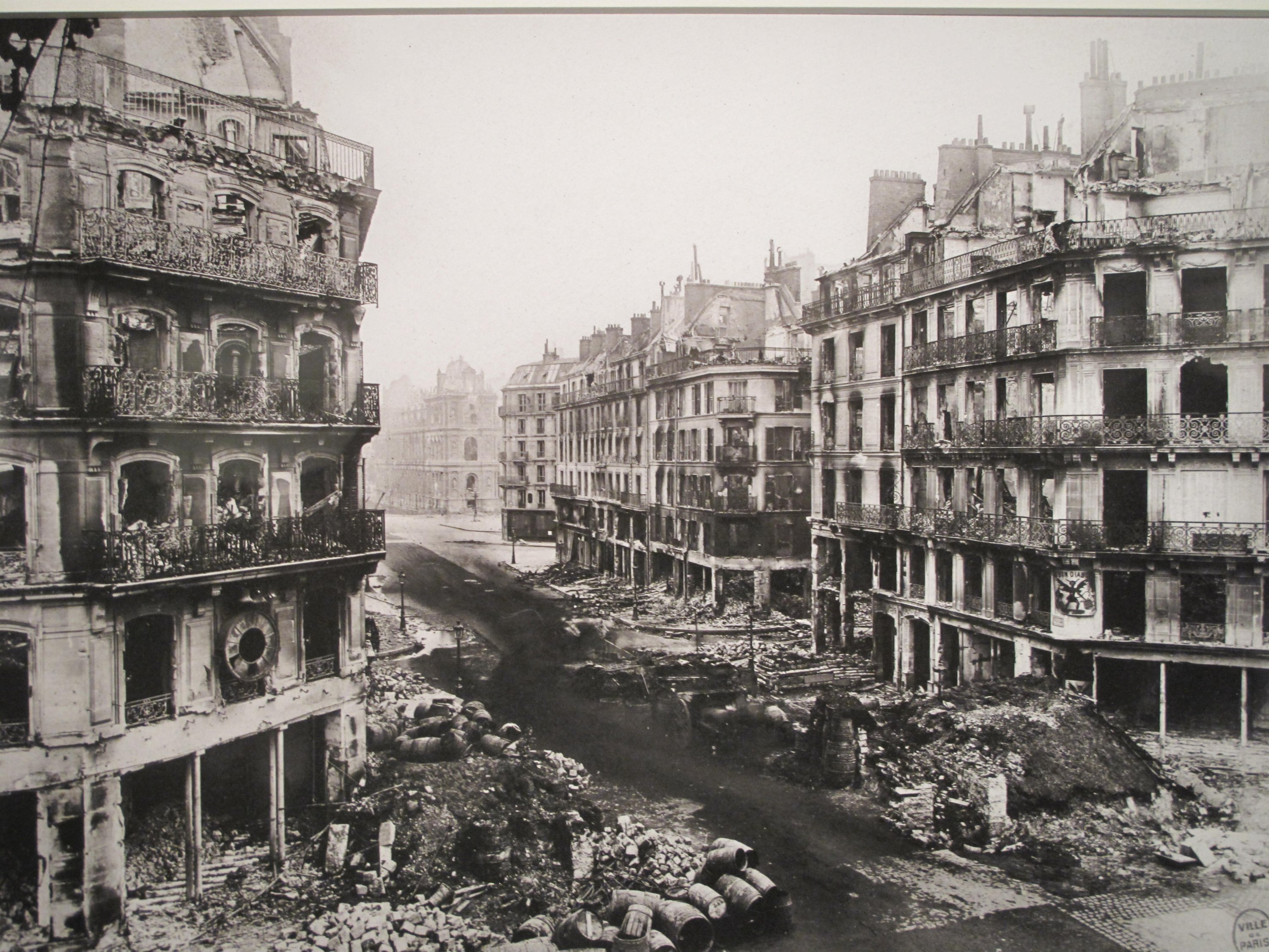 This undated file photo shows the destruction at the Rue de Rivoli in central Paris following the devastating clashes between government forces and Paris communards. (Wikimedia Photo)