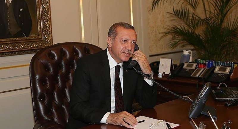 President Recep Tayyip Erdoğan speaks on the phone in this undated photo (File Photo)