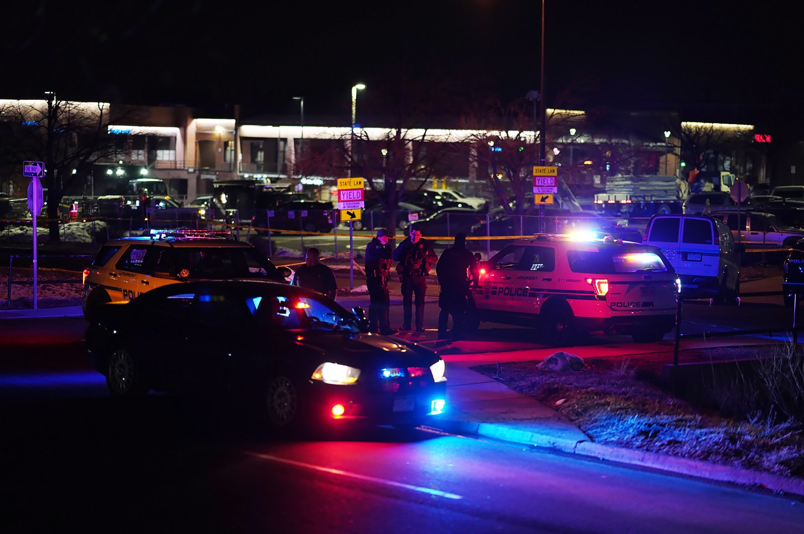 Police and officials investigate the scene of a mass shooting at the King Soopers supermarket in Boulder, Colorado, U.S., March 22, 2021. (EPA Photo)