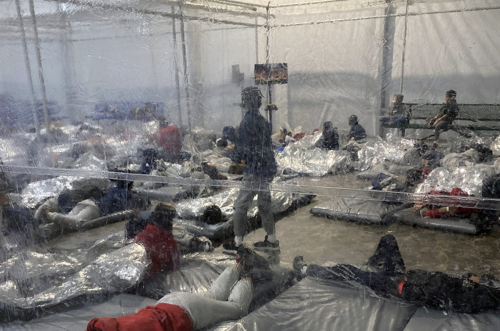 Detainees in a Customs and Border Protection (CBP) temporary overflow facility in Donna, Texas, U.S., March 20, 2021. (Photo provided by the Office of Rep. Henry Cuellar, D-Texas, via AP)