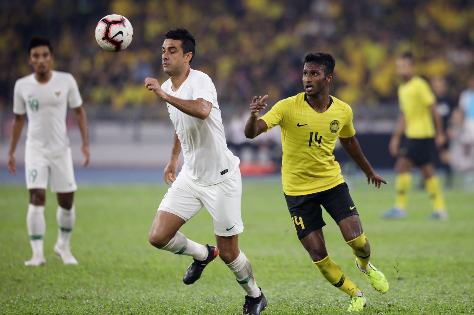 Malaysia's Syamer Abba (R) in action against Indonesia in a World Cup 2022 Qualifier match at Bukit Jalil National Stadium, Kuala Lumpur, Malaysia, Nov. 19, 2019. (Reuters Photo)