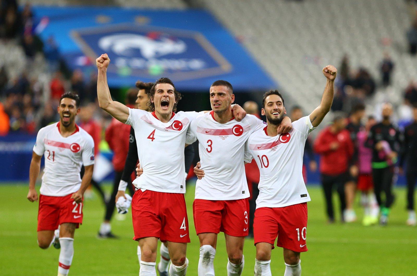 Turkey's Çağlar Söyüncü (L), Merih Demiral (C) and Hakan Çalhanoğlu celebrate after a match against France, at the Stade de France, Paris, France, Sept. 14, 2019. (Sabah Photo)