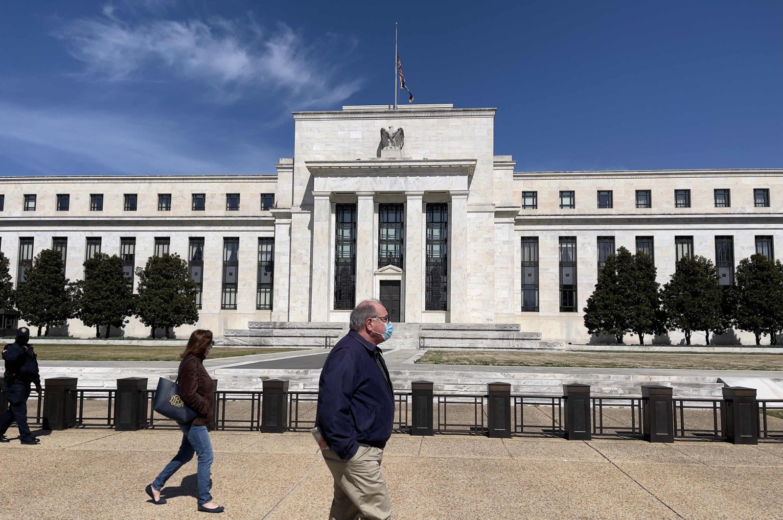 People walk past the Federal Reserve building in Washington, D.C., U.S., March 19, 2021. (AFP Photo)