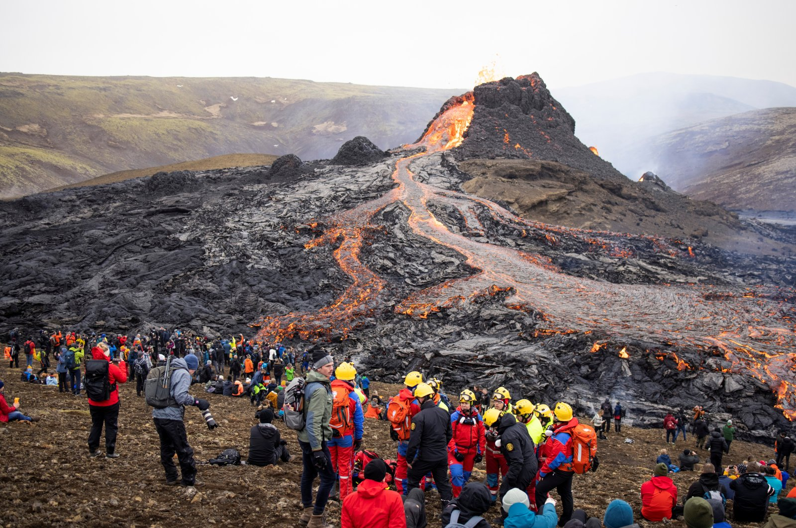 People gather at the volcanic site on the Reykjanes Peninsula following Friday's eruption in Iceland, March 21, 2021. (Reuters Photo)