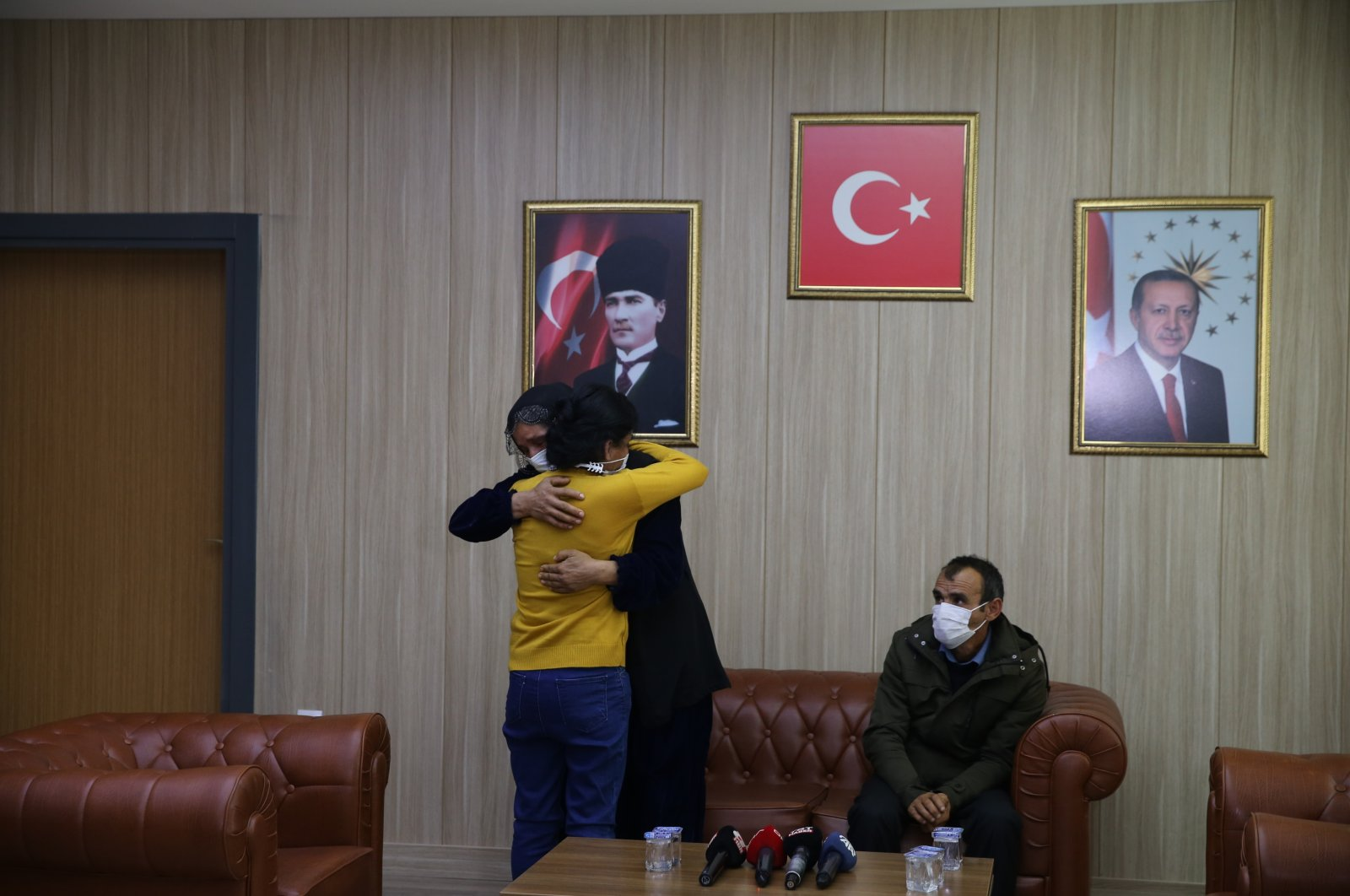 A surrendered PKK member reunites with her family in southeastern Mardin province, Turkey, March 19, 2021. (AA Photo)
