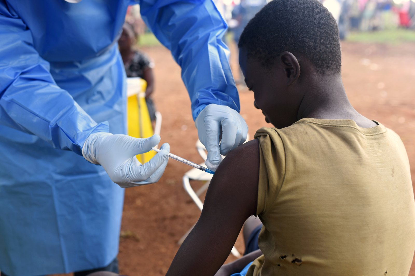 A Congolese health worker administers the Ebola vaccine to a boy who had contact with an Ebola patient in the village of Mangina in North Kivu province of the Democratic Republic of Congo, Africa, Aug. 18, 2018. (Reuters Photo)