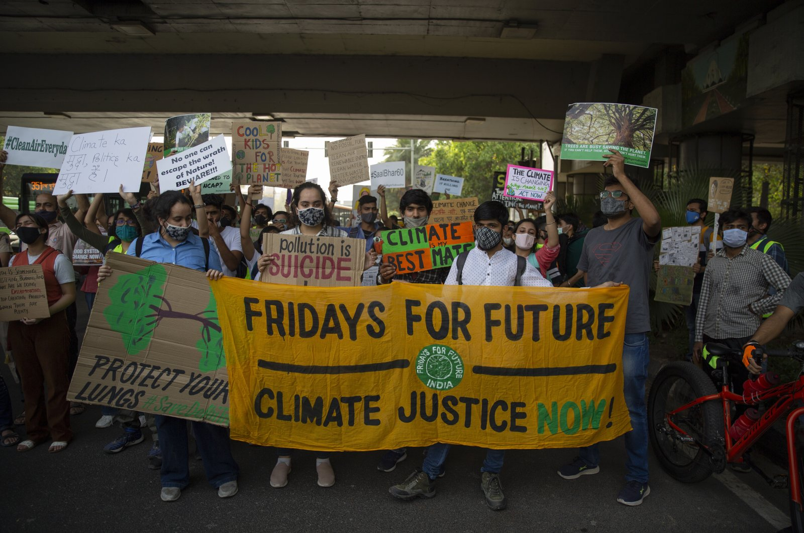 Student activists carry posters and shout slogans as they participate in a protest march against climate change in New Delhi, India, March 19, 2021. (AP Photo)