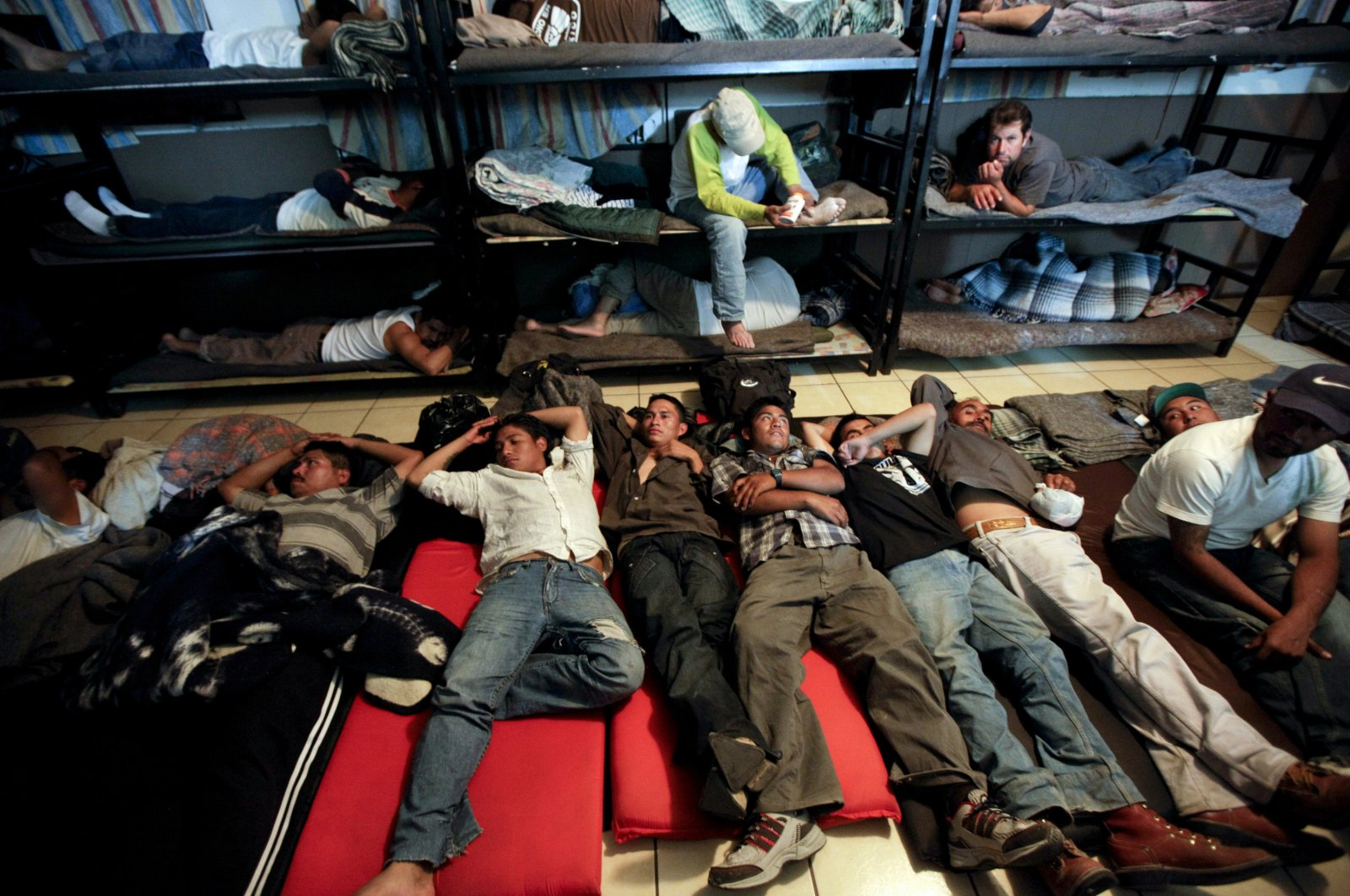 Men sleep in a crowded shelter for migrants deported from the United States, in the border city of Nogales, Mexico, April 28, 2010. (AP Photo)