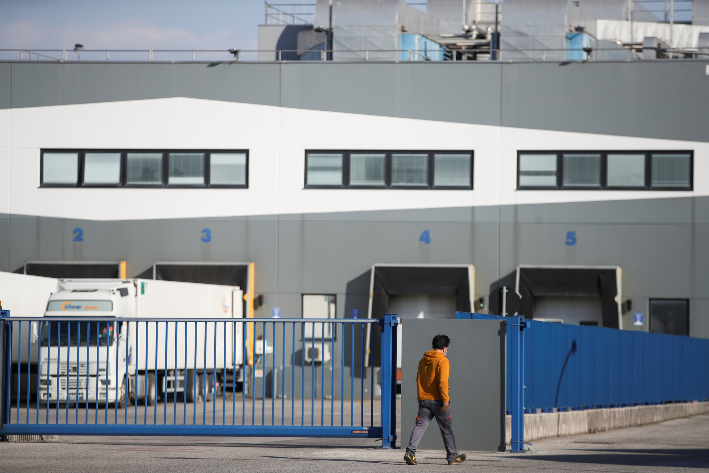 A man walks outside the Catalent plant where millions of doses of the AstraZeneca's COVID-19 vaccine were reportedly found, in Anagni, Italy, March 24, 2021. (Reuters Photo)