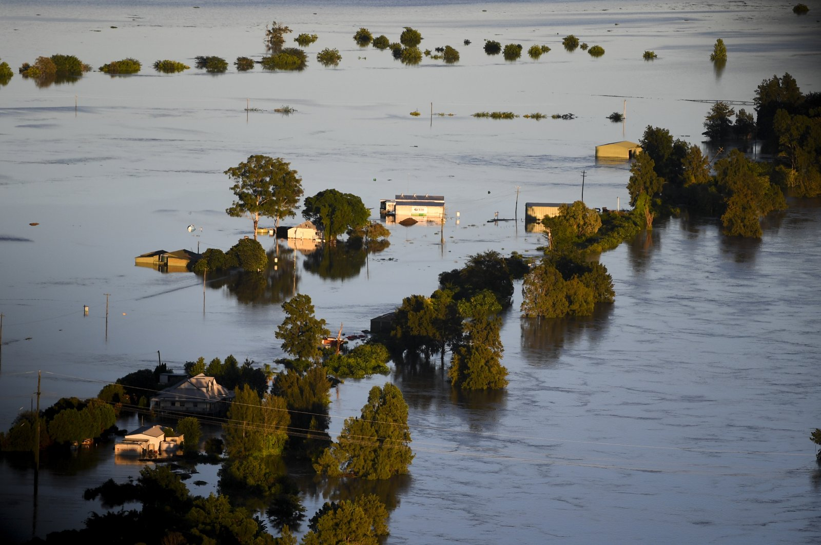Flood-affected areas are seen from a helicopter in the Windsor and Pitt Town areas along the Hawkesbury River near Sydney, Australia, March 24, 2021. (EPA Photo)