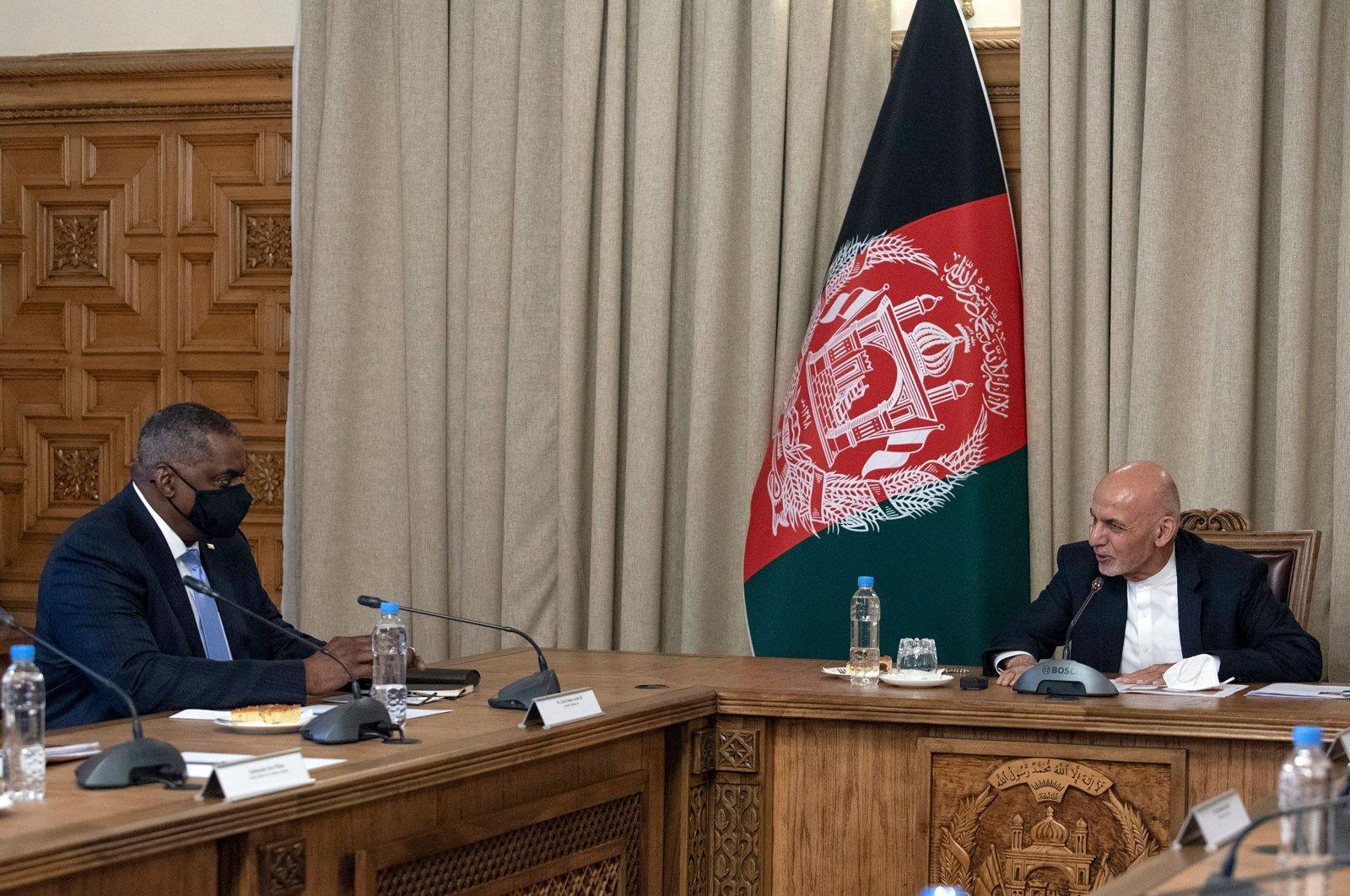 U.S. Secretary of Defense Lloyd J. Austin (L) meets with Afghan President Ashraf Ghani, in Kabul, Afghanistan, March 21, 2021. (AFP Photo)