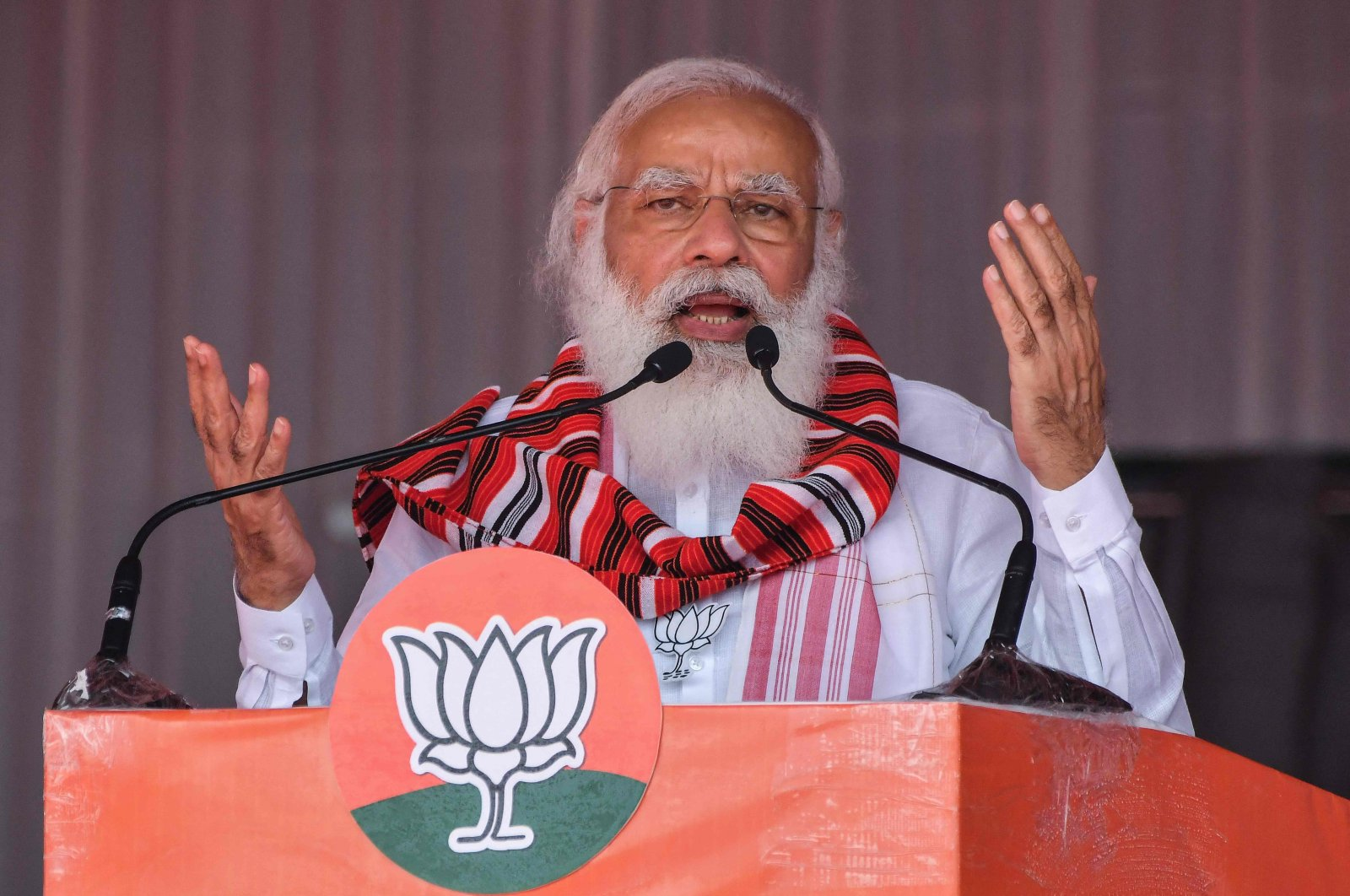 India's Prime Minister Narendra Modi gestures as he addresses a public meeting ahead of Assam Assembly elections, in Bokakhat, India, March 21, 2021. (AFP)