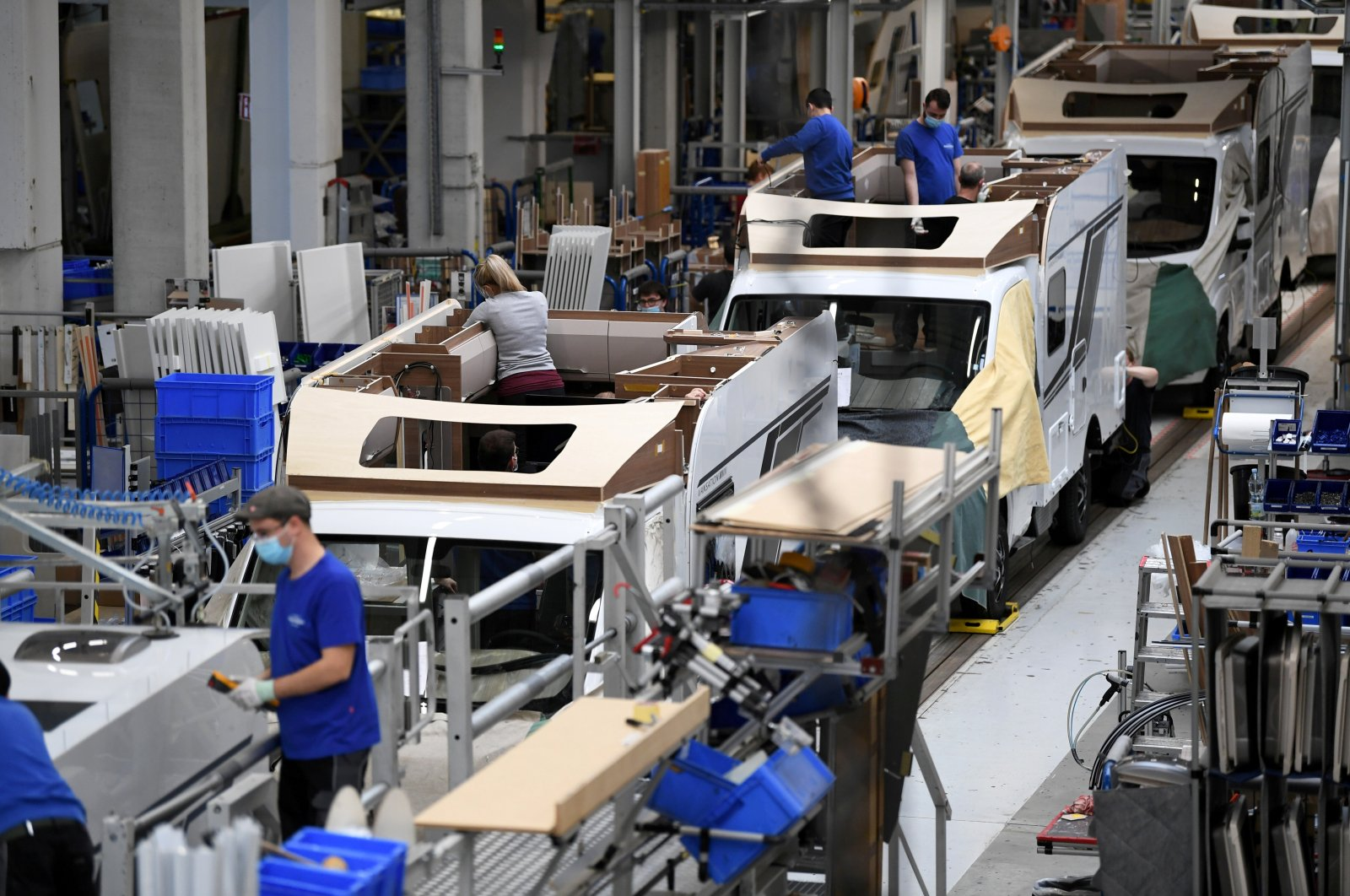 Workers assemble campers at Knaus-Tabbert AG factory in Jandelsbrunn near Passau, Germany, March 16, 2021. (Reuters Photo)