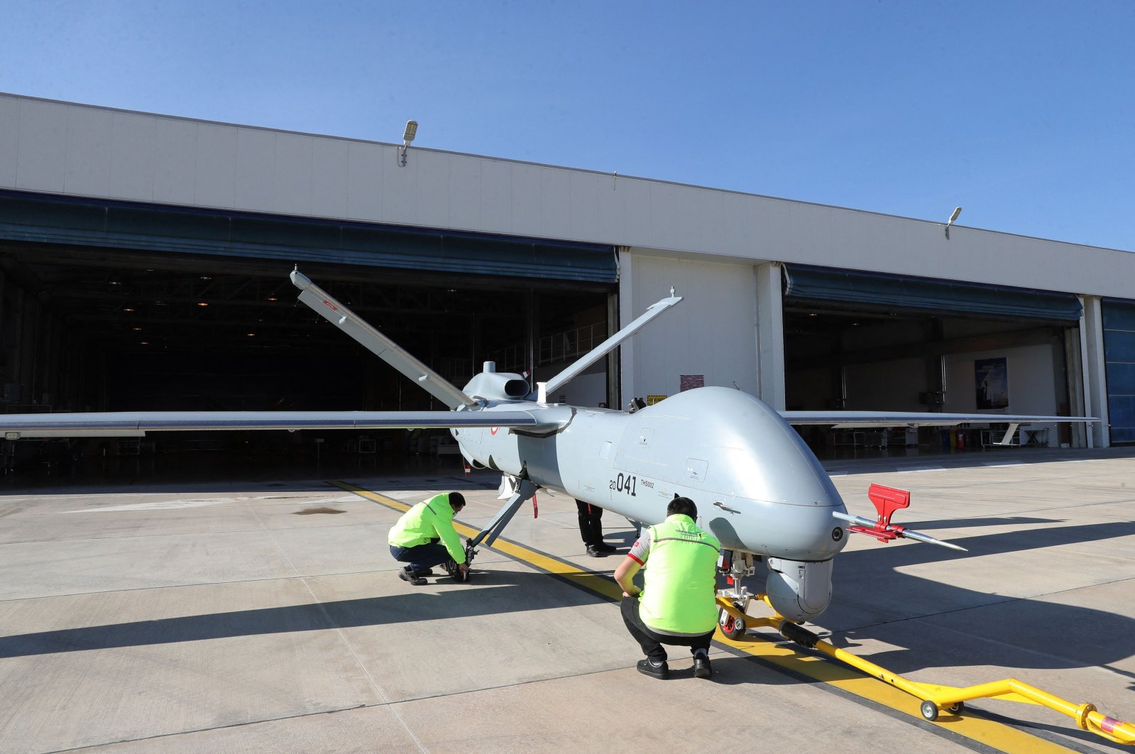 TAI's Anka drone is checked by employees in Ankara, Turkey, March 5, 2021. (AFP Photo)