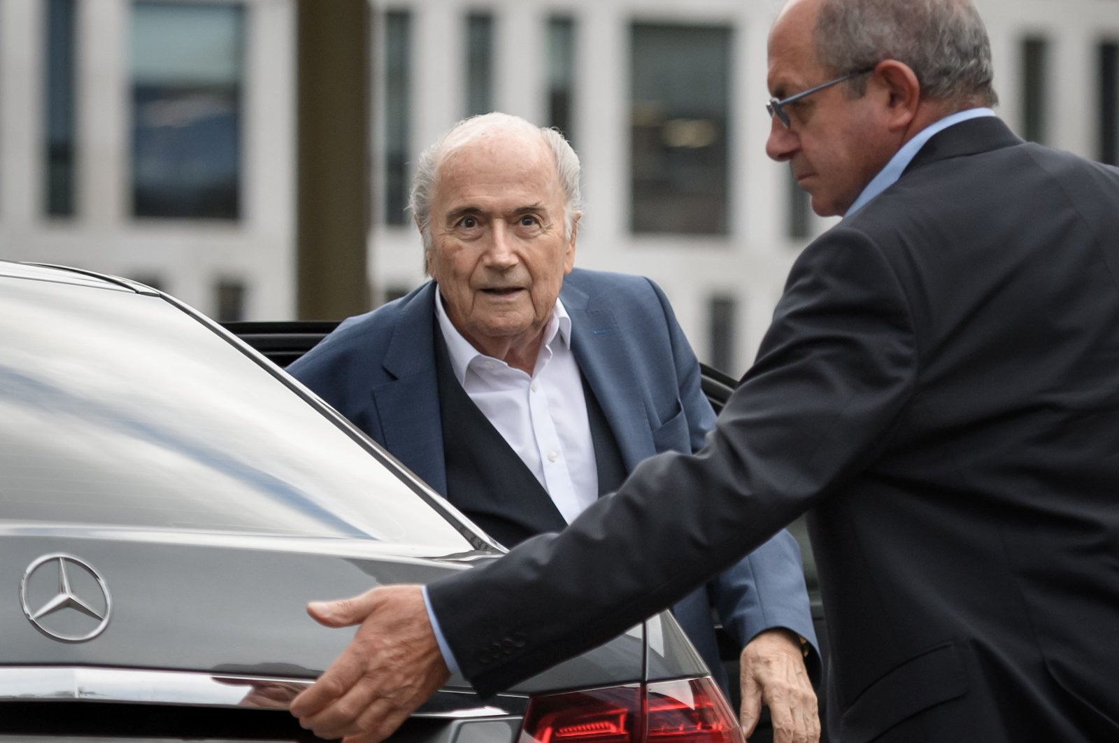 Former president of World football's governing body FIFA, Sepp Blatter (L) arrives at a hearing after being summoned by Swiss prosecutor Thomas Hildbrand, Bern, Switzerland, Sept. 1, 2020. (AFP Photo)