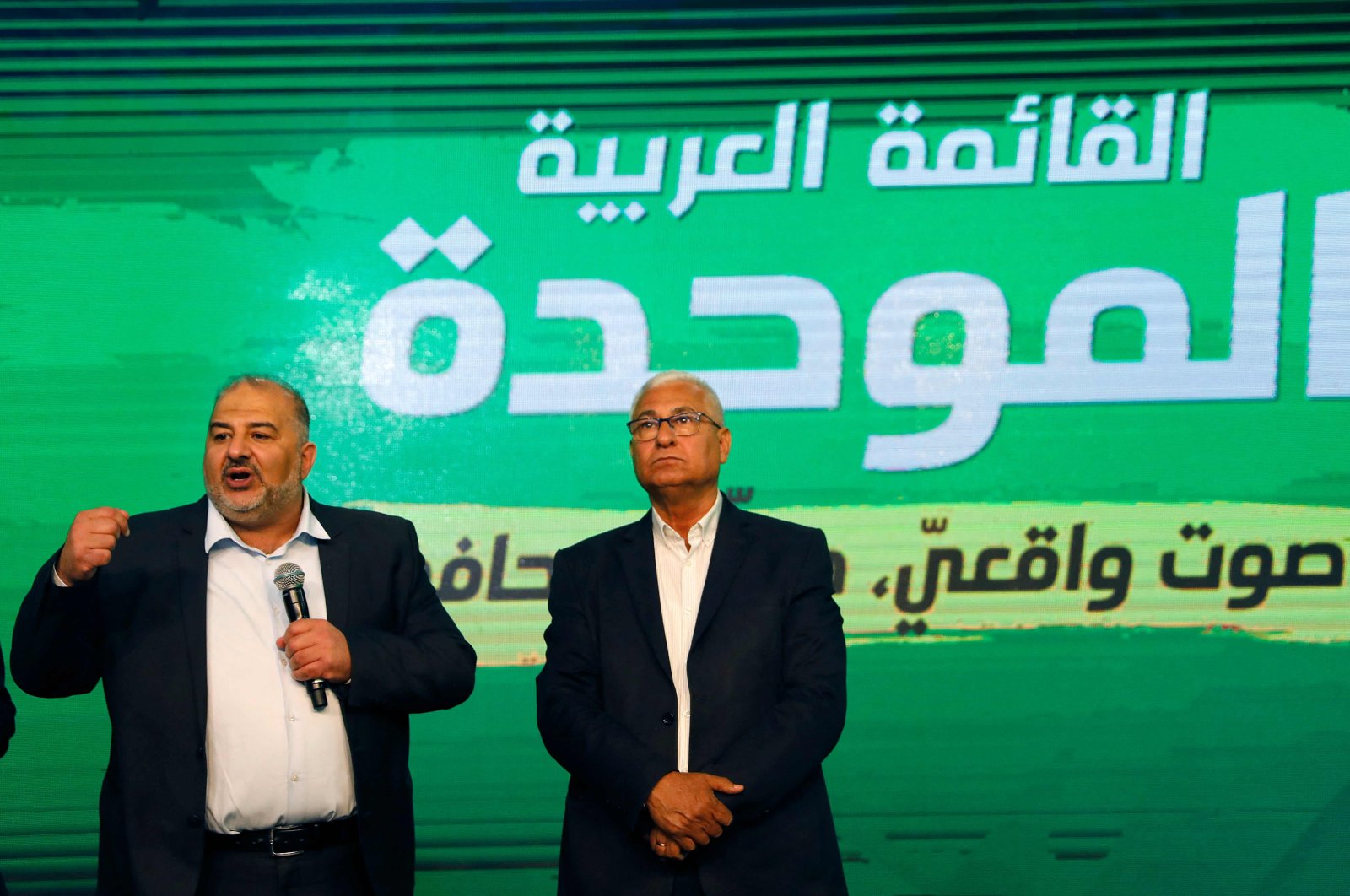 Mansour Abbas (L), leader of the United Arab List, speaks to supporters from his campaign headquarters in the northern Israeli city of Tamra, Israel, March 23, 2021. (AFP Photo)