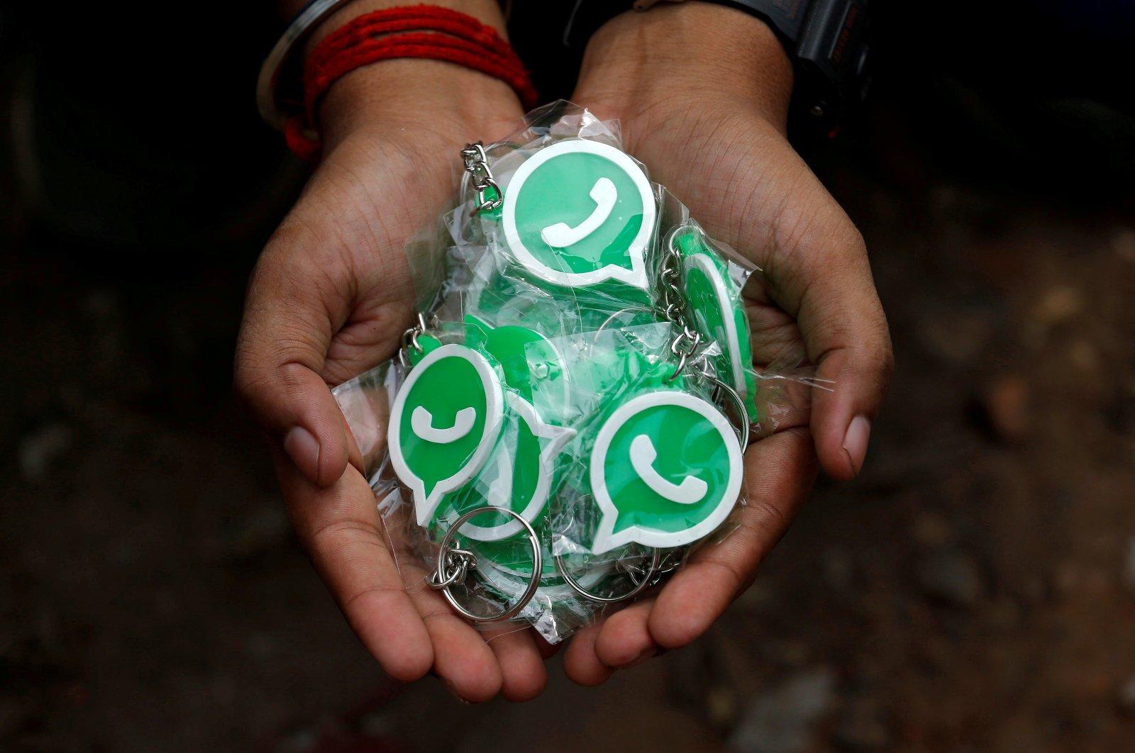 Key chains with the logo of WhatsApp, Kolkata, India, Oct. 9, 2018. (Reuters Photo)