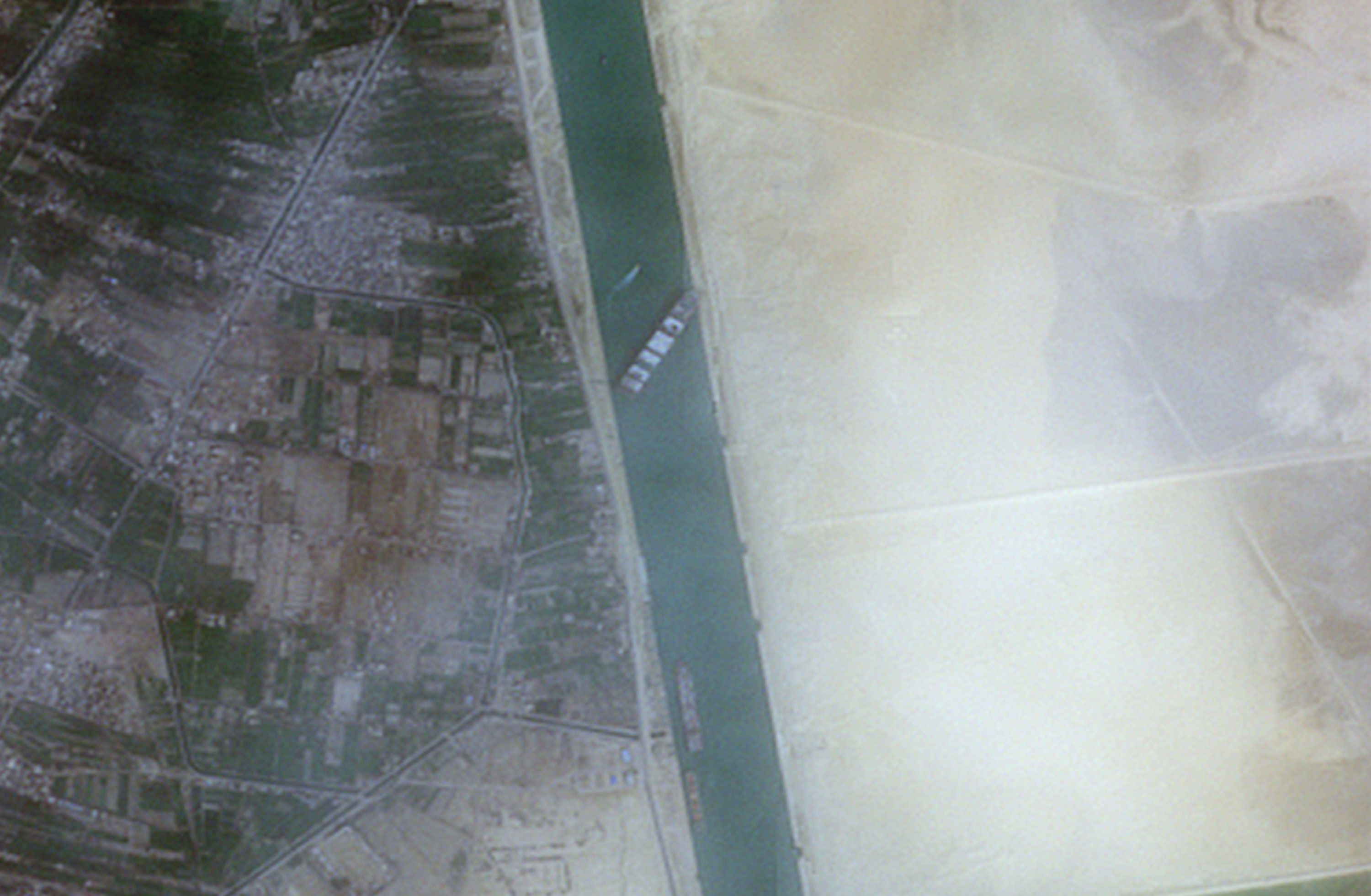 A closer view of the Ever Given container ship seen blocking the Suez Canal in this satellite image, March 24, 2021. (Reuters Photo)