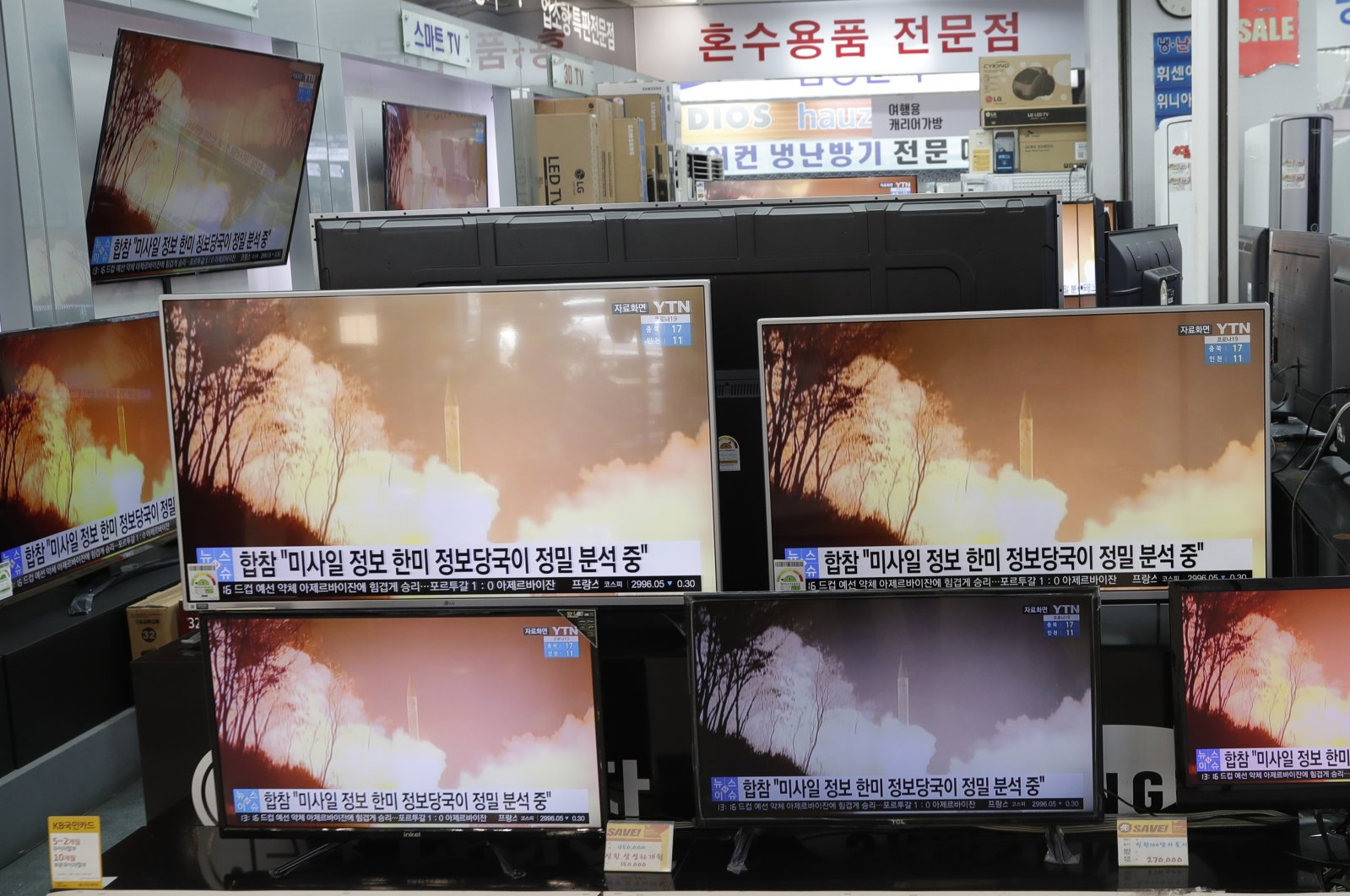 TV screens show a news program reporting about North Korea's missiles with file footage at an electronic shop in Seoul, South Korea, March 25, 2021. (AP Photo)