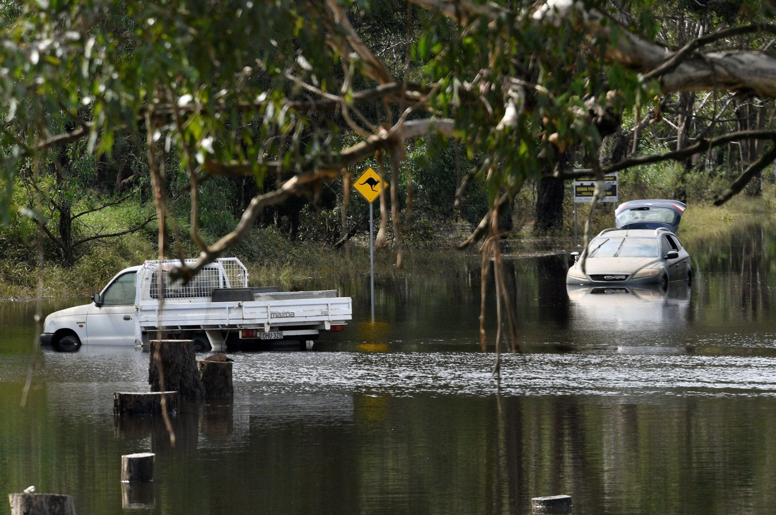 Cars sit in floodwaters as flood-stricken residents along Australia's east coast began a massive clean up effort following days of floods, Londonderry,Sydney, March 25, 2021. (AFP Photo)