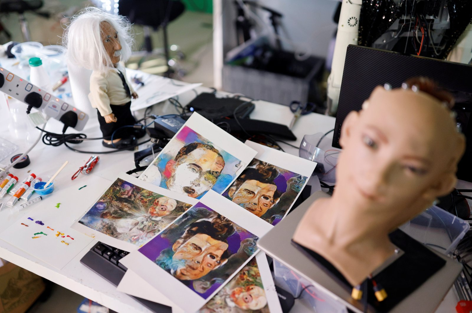 Paintings of humanoid robot Sophia are seen at her studio before auctioning her own nonfungible token (NFT) artwork, in Hong Kong, China, March 17, 2021. (REUTERS Photo)