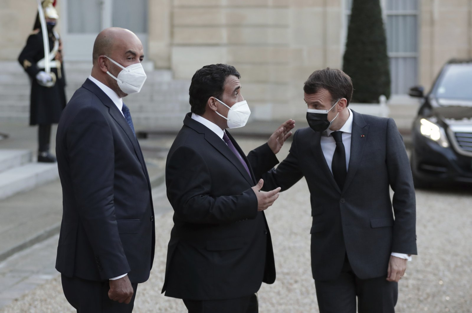 French President Emmanuel Macron (R), talks with Mohammad Younes Menfi, president of Libya's Presidential Council (C), and Musa al-Koni, vice-president of Libya's Presidential Council (L), at the end of a meeting, at the Elysee Palace, in Paris, March 23, 2021. (AP Photo)