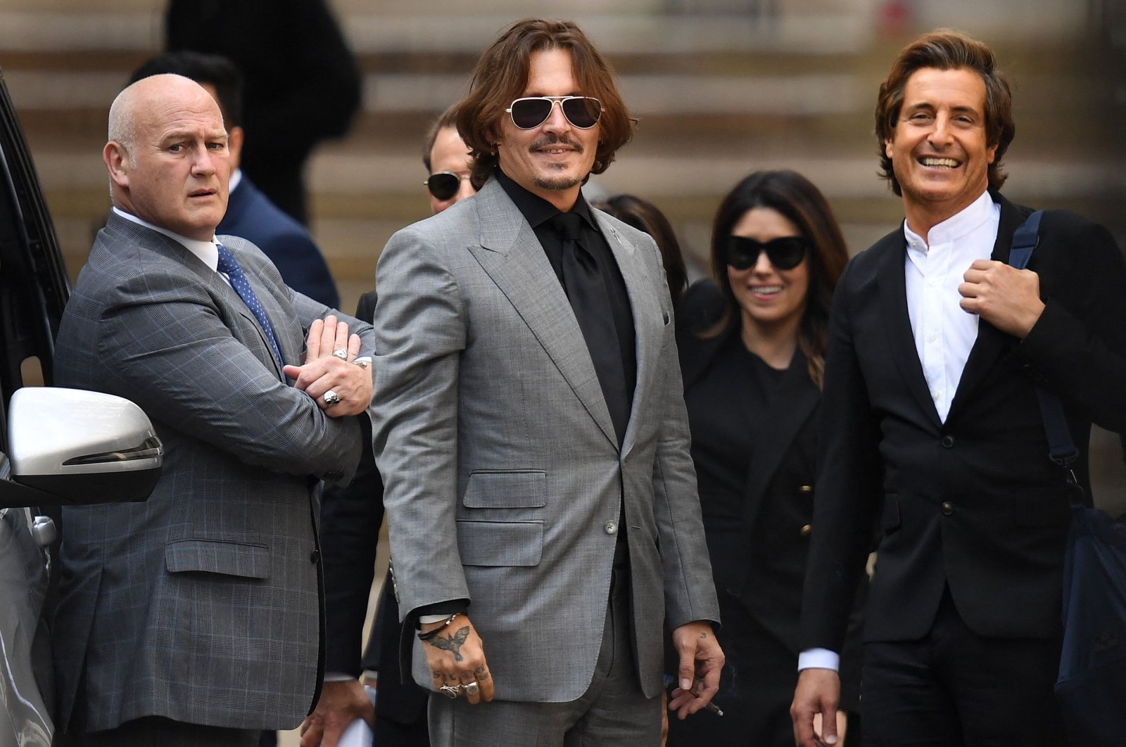 In this file photo taken on July 28, 2020 actor Johnny Depp gestures as he leaves the High Court after the final day of his libel trial against News Group Newspapers (NGN), in London. (AFP Photo)