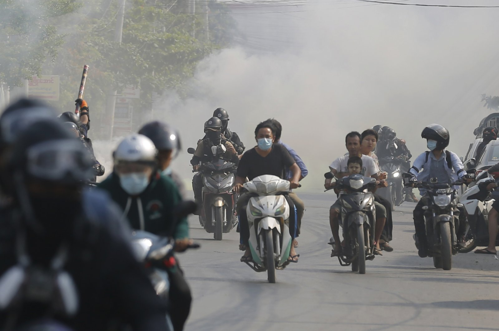 Protesters drive their motorcycles during an anti-coup protest in Mandalay, Myanmar, March 25, 2021. (AP Photo)