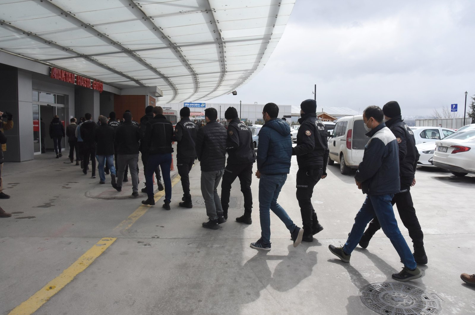 Police escort a group of FETÖ suspects after they were captured in Eskişehir, central Turkey, March 25, 2021. (DHA PHOTO)