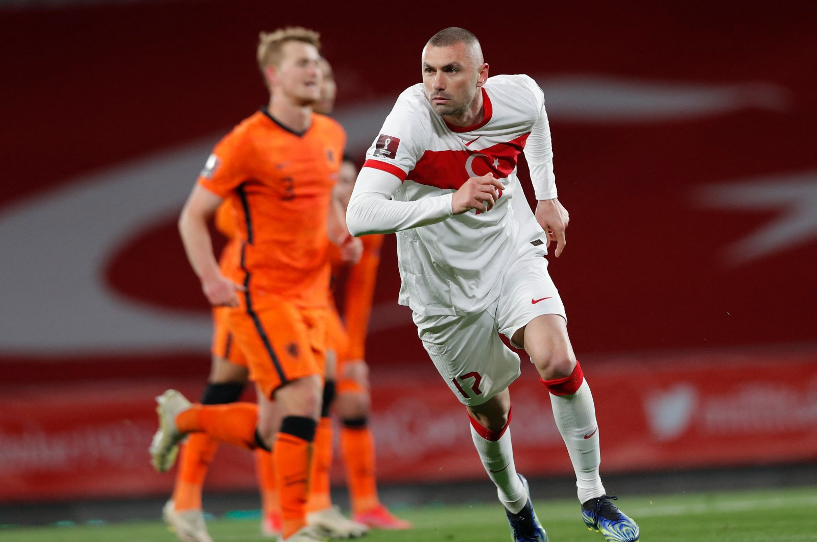 Turkey forward Burak Yılmaz celebrates after scoring his second goal during the FIFA World Cup Qatar 2022 qualification Group G match against The Netherlands at the Atatürk Olympic Stadium, in Istanbul, Turkey, March 24, 2021. (AFP Photo)