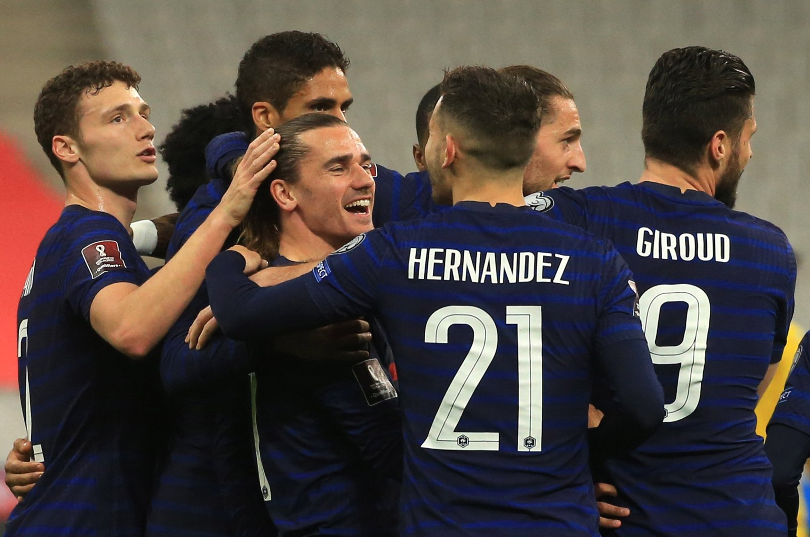 French midfielder Antoine Griezmann (C) celebrates after scoring the opening goal during the 2022 FIFA World Cup qualification UEFA Group D match against Ukraine in Saint Denis, Paris, France, March 24, 2021. (EPA Photo)