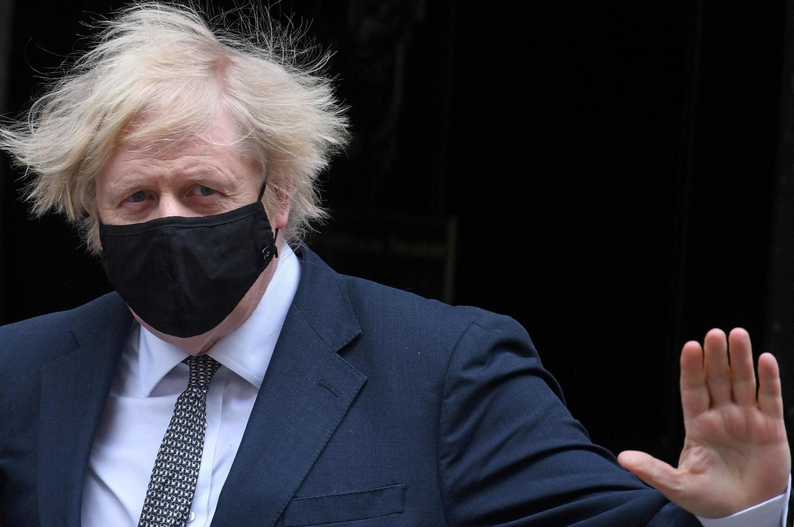 Britain's Prime Minister Boris Johnson, wearing a face mask, leaves 10 Downing Street in central London, U.K., March 24, 2021. (AFP Photo)