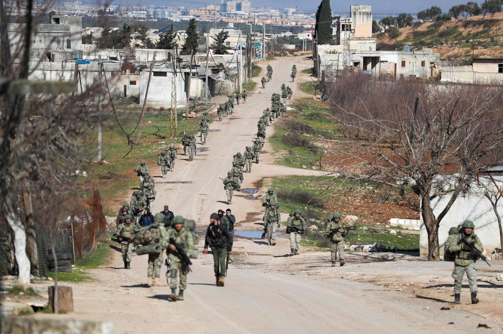 Turkish soldiers gather in the village of Qaminas, about 6 kilometers (3.7 miles) southeast of Idlib city in northwest Syria, Feb. 10, 2020. (AFP File Photo)