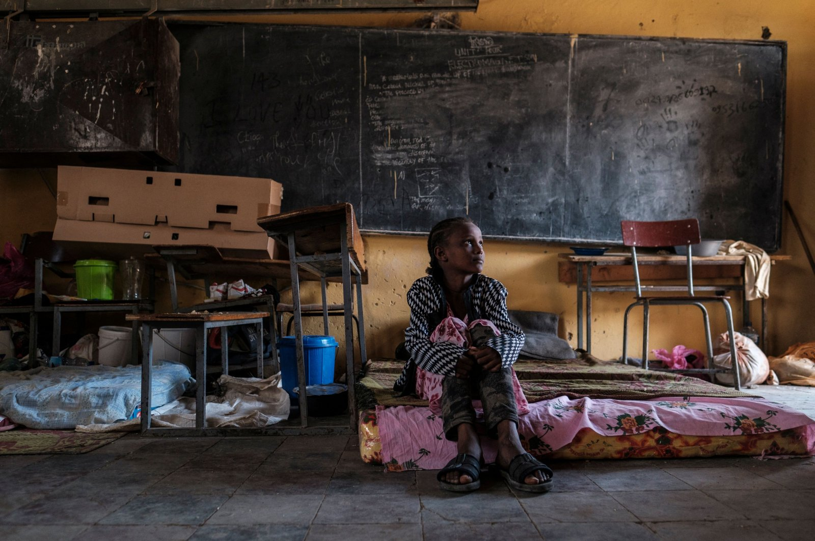 A displaced girl from Western Tigray sits on a mattress in a classroom at the school where she is sheltering in Tigray's capital Mekele, Ethiopia, Feb. 24, 2021. (AFP Photo)