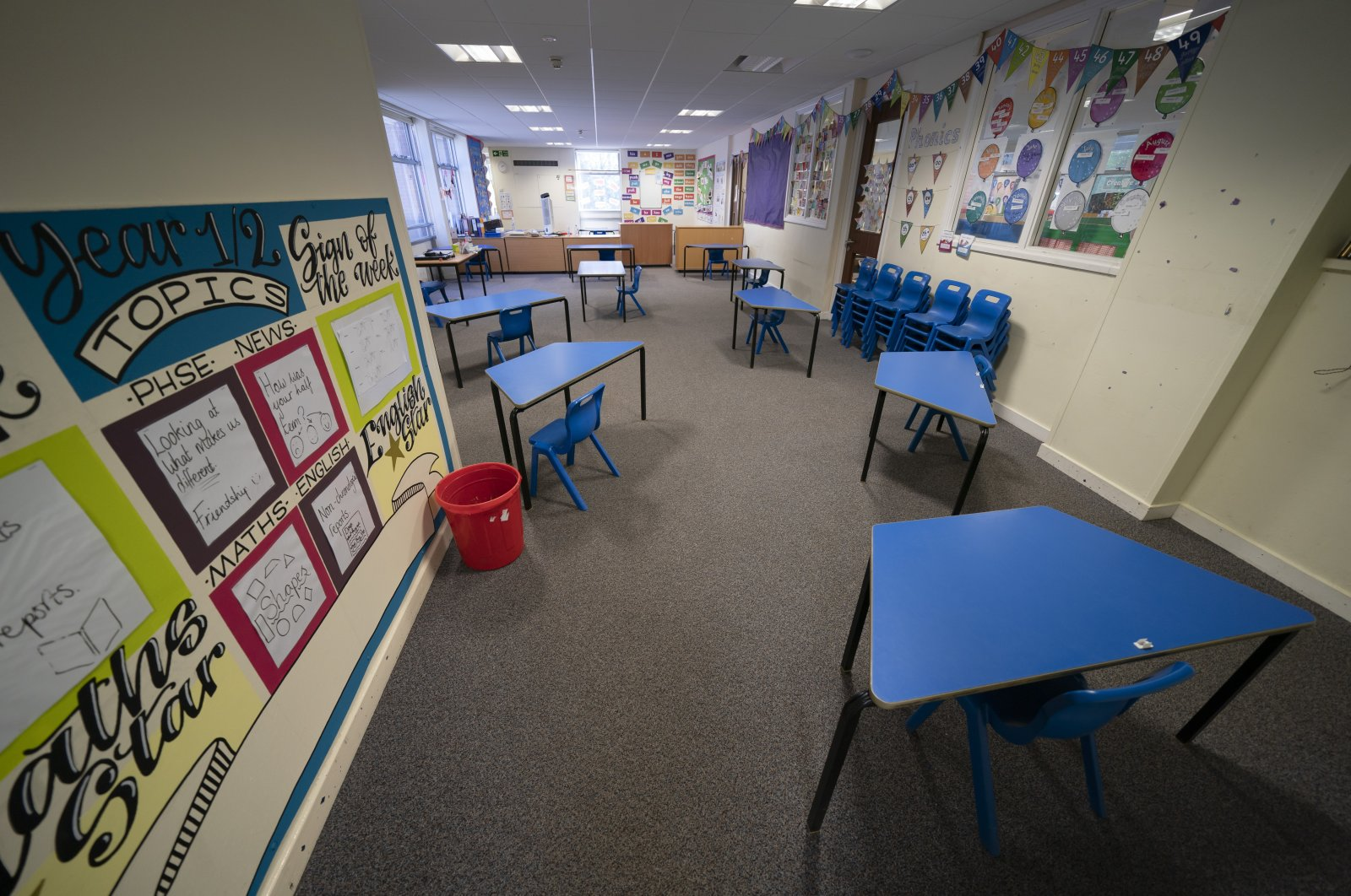 A classroom with safely spaced desks laid out before the possible reopening of Lostock Hall Primary school in Poynton near Manchester, U.K., May 20, 2020. (AP Photo)