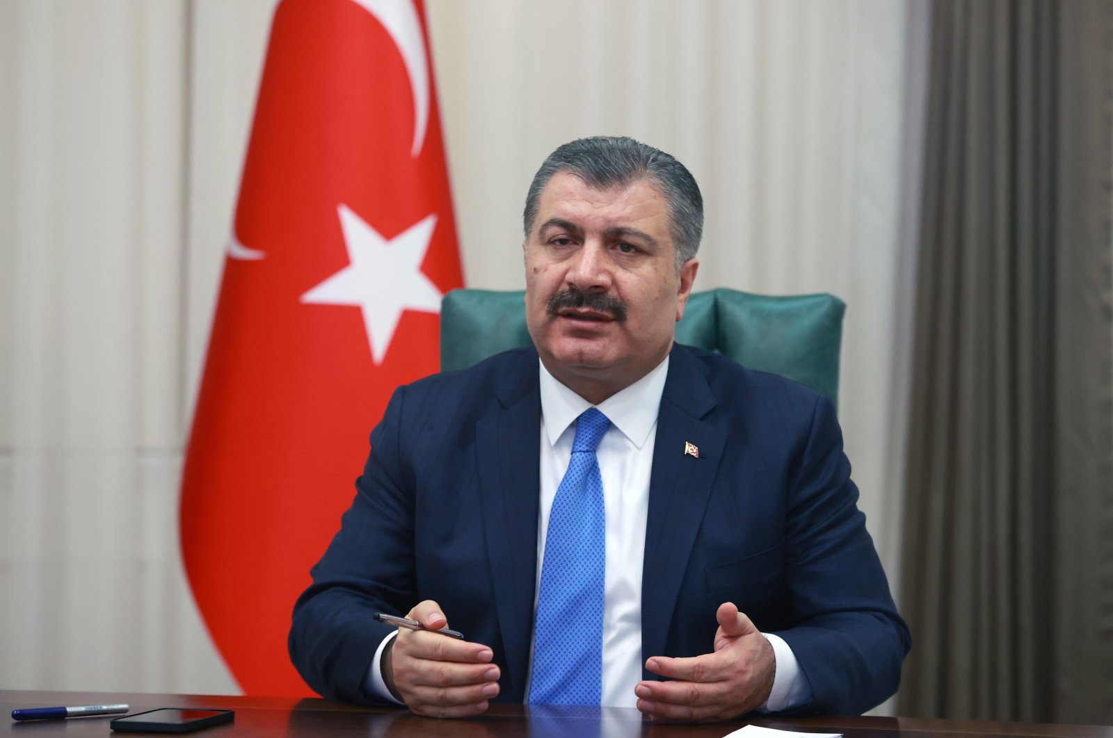 Health Minister Fahrettin Koca speaks during a videoconference in Ankara on Mar. 25, 2021 (AA Photo)