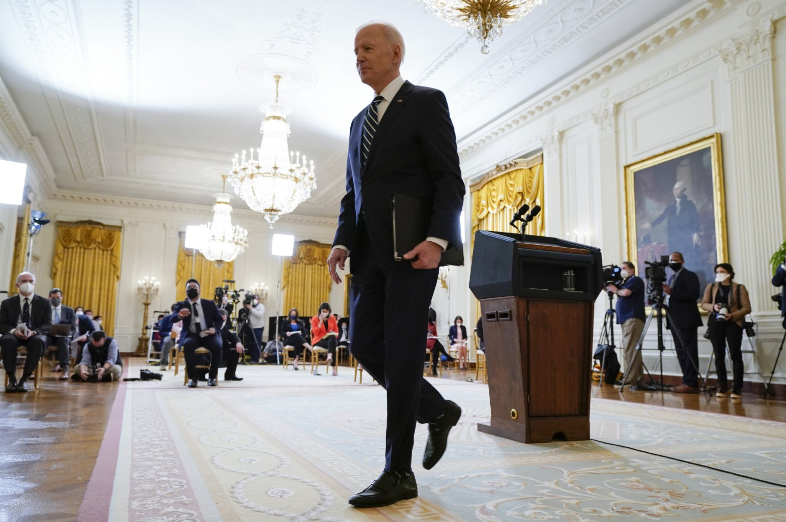 President Joe Biden leaves after speaking at a news conference in the East Room of the White House, Thursday, March 25, 2021, in Washington. (AP Photo)