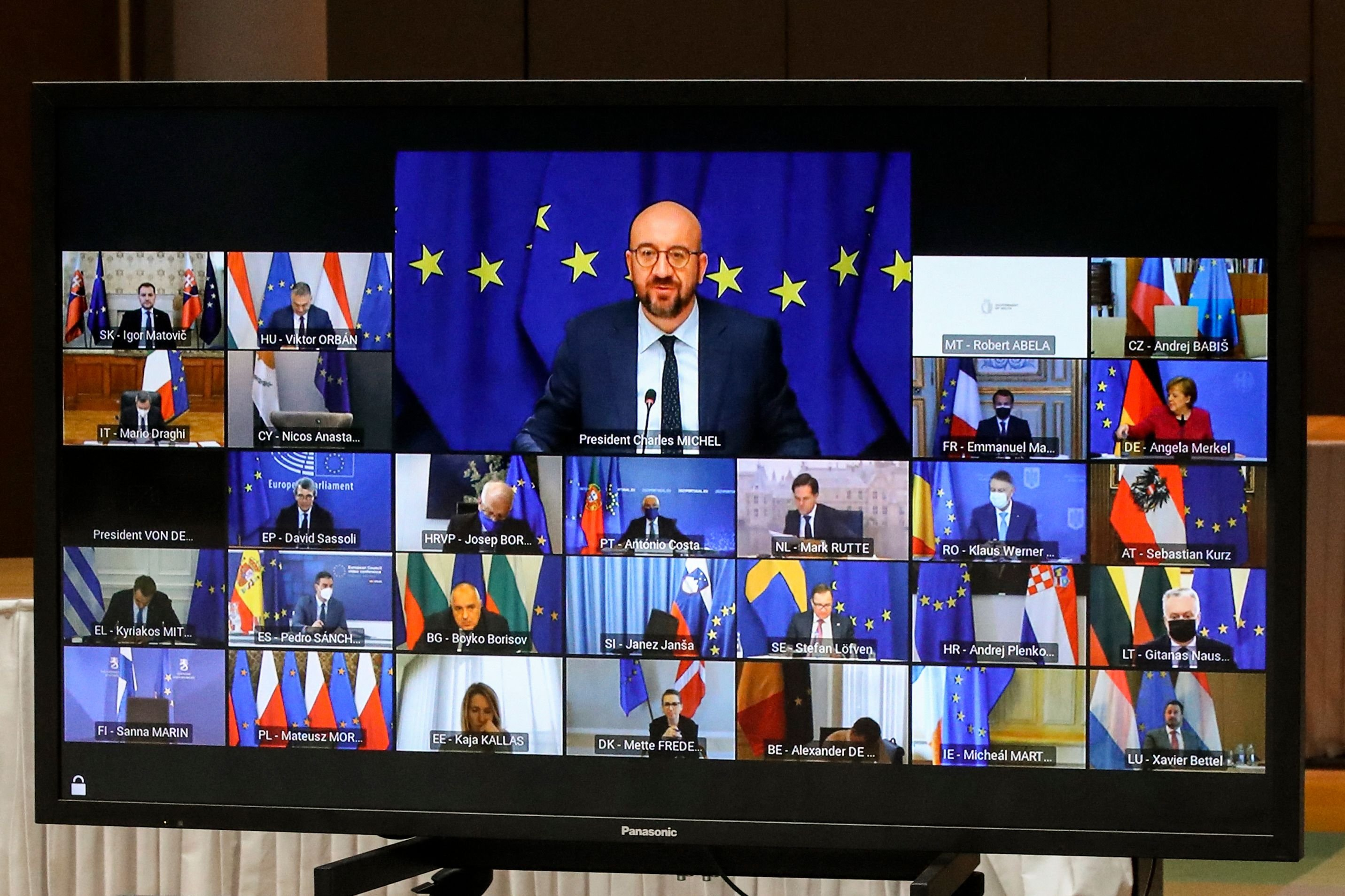 European Council President Charles Michel (top C) on a screen during a European Union (EU) summit over video conference with the EU leaders at the European Council Building in Brussels, Belgium, March 25, 2021. (AFP)