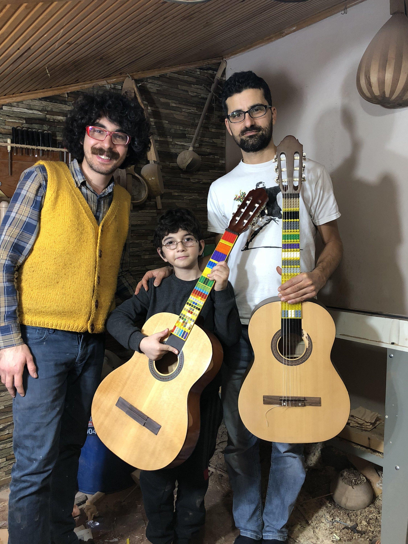 Ruşen Can Acet (L), Atlas Çoğulu (C) and Tolgahan Çoğulu pose with their Lego Microtonal Guitars. (Courtesy of Tolgahan Çoğulu)