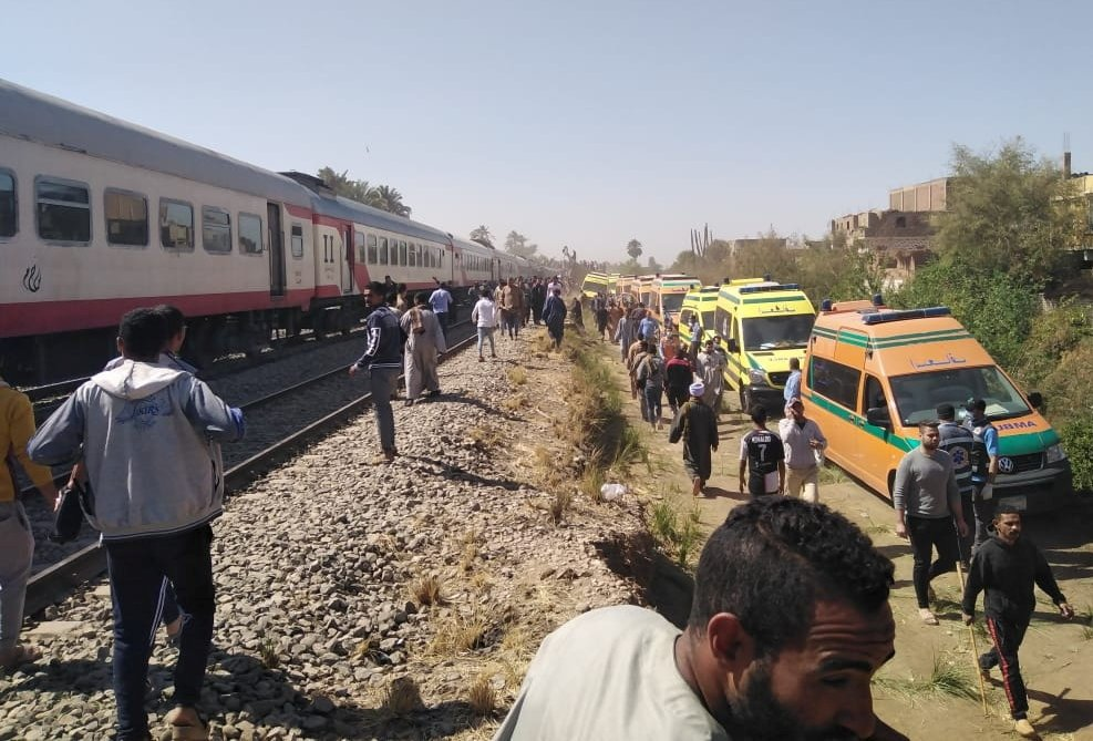 Medical staff and people inspect the damage after two trains collided near the city of Sohag, Egypt, March 26, 2021. (Reuters Photo)