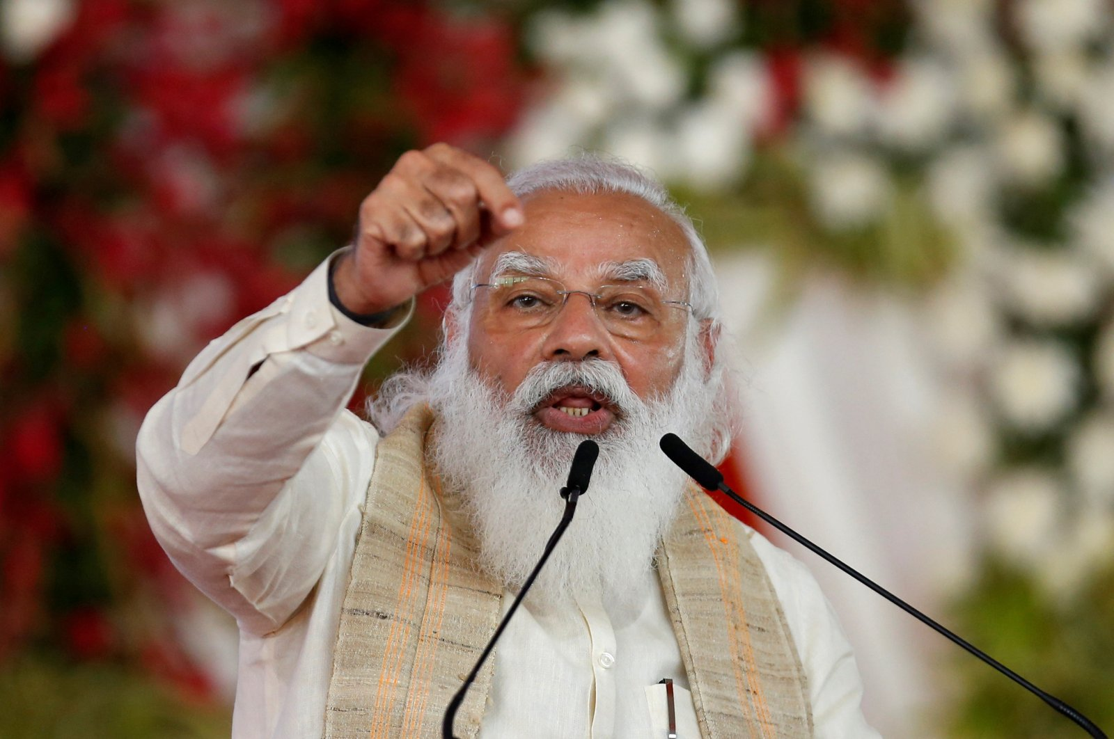 """India's Prime Minister Narendra Modi addresses a gathering before flagging off the """"Dandi March,"""" or Salt March, to celebrate the 75th anniversary of India's Independence, in Ahmedabad, India, March 12, 2021. (Reuters Photo)"""