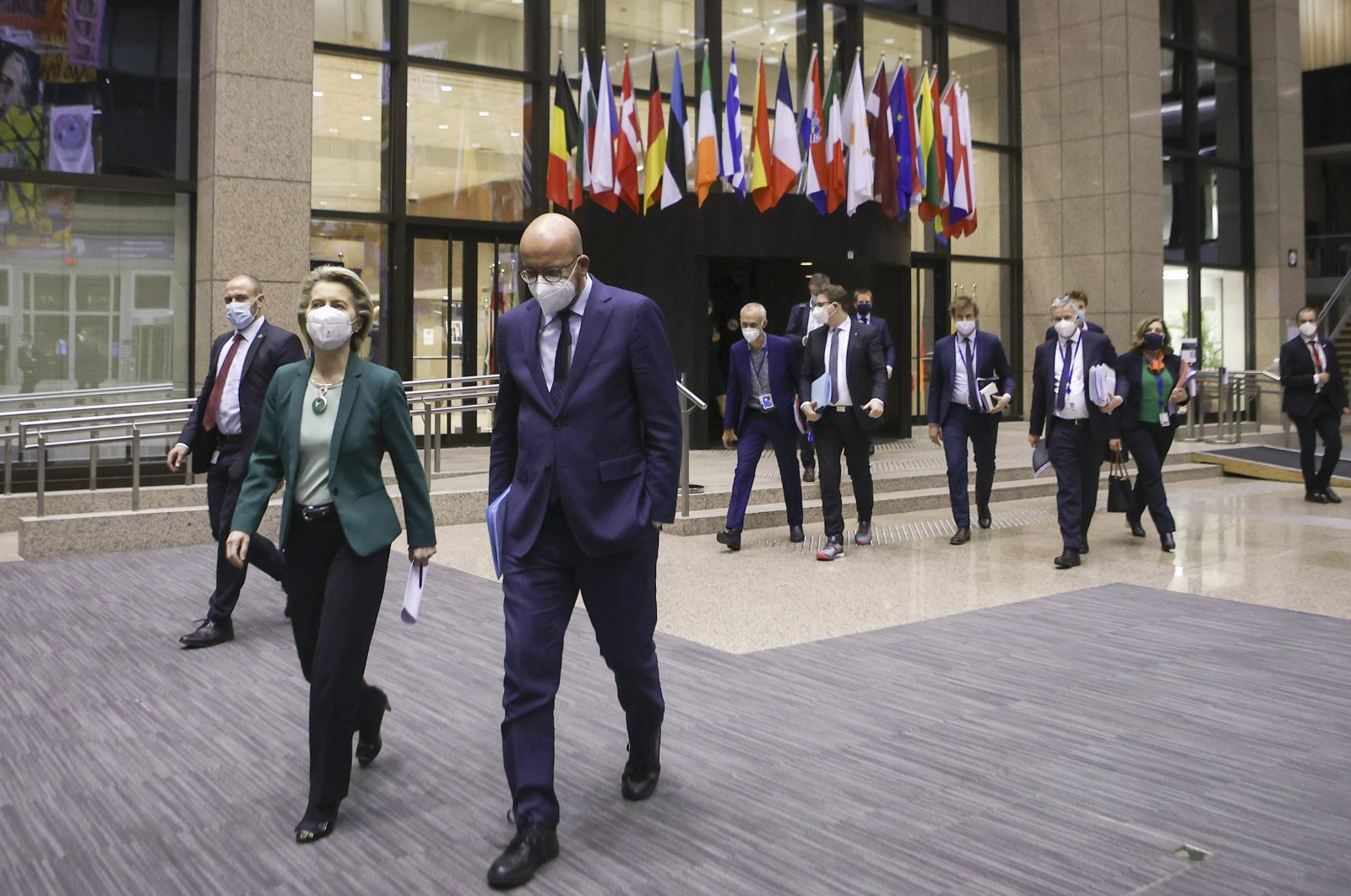European Commission President Ursula von der Leyen (L) and European Council President Charles Michel arrive for an online joint news conference at the end of a European Union summit at the European Council building in Brussels, Belgium, March 25, 2021. (AP)