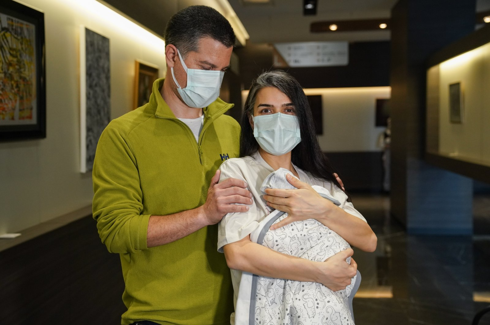 Deniz Giray (L) with mother Seda Giray pose for a photo with their newborn baby Devin Ege inside a private hospital in Istanbul, Turkey, March 25, 2021. (DHA Photo)