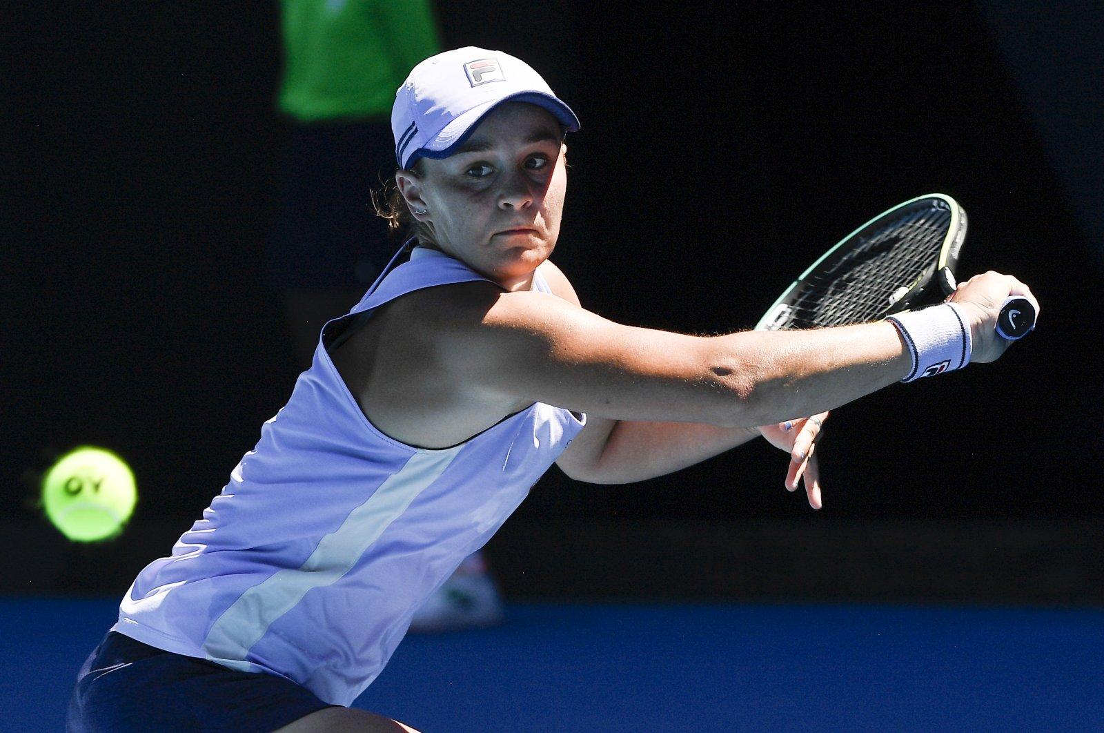 Ash Barty hits a backhand return during a quarterfinal match against Karolina Muchova at the Australian Open tennis championship in Melbourne, Australia, Feb. 17, 2021. (AP Photo)