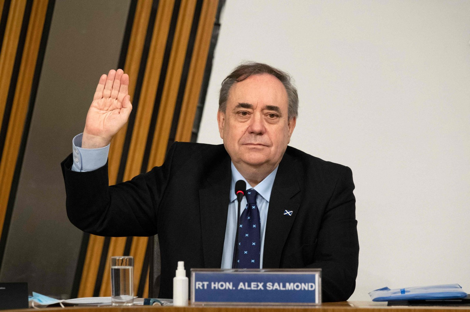 The former Scottish National Party leader and former first minister of Scotland, Alex Salmond, is sworn in before giving evidence to The Committee on the Scottish Government Handling of Harassment Complaints examining the government's handling of harassment allegations against him at Holyrood in Edinburgh, Scottland, Feb. 26, 2021. (AFP)