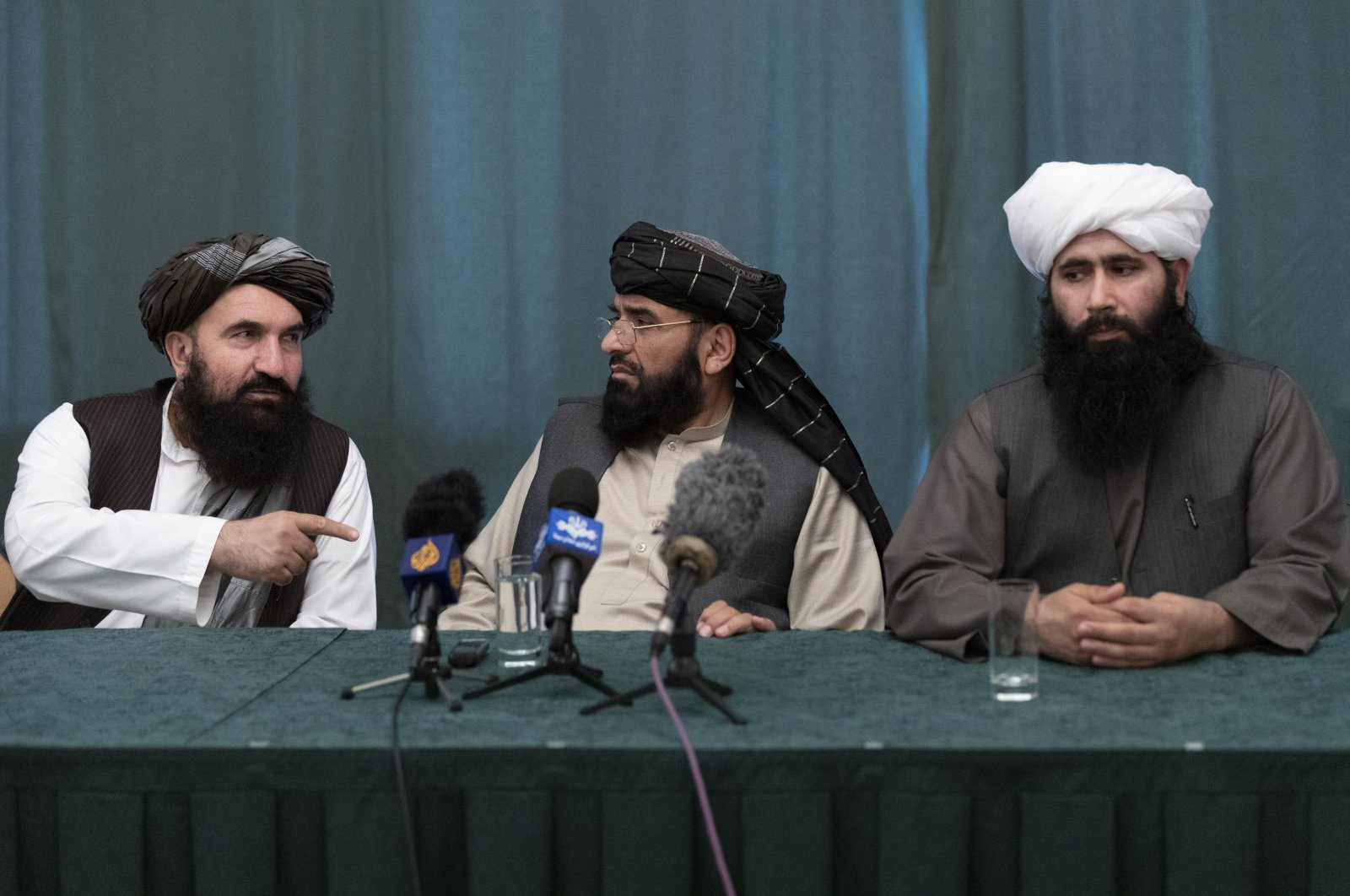 """Members of the Taliban delegation warned Washington against defying the May 1 deadline for the withdrawal of American and NATO troops from Afghanistan promising a """"reaction,"""" which presumably meant stepped up fighting, in a news conference in Moscow, Russia, March 19, 2021. (EPA)"""