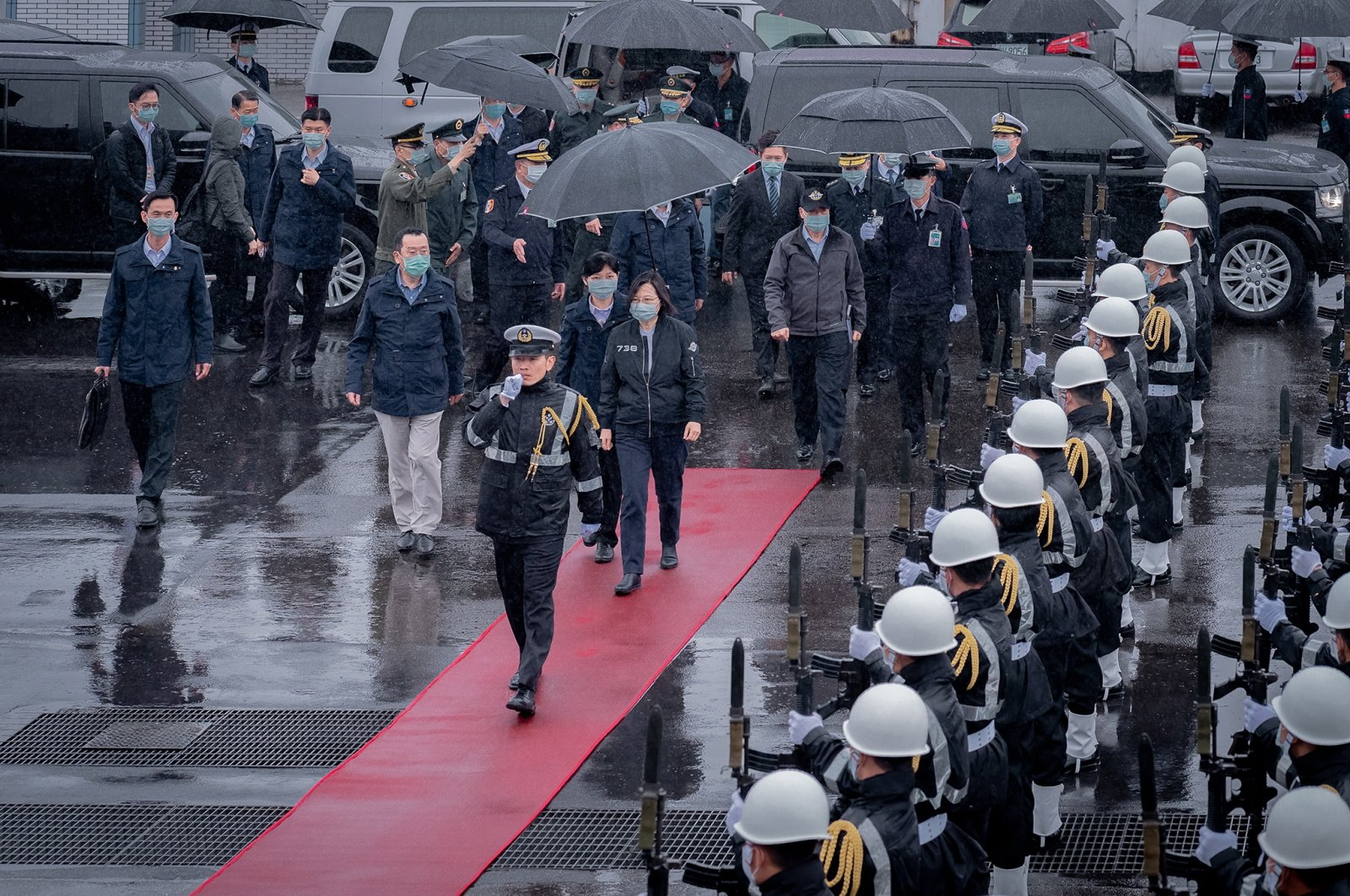 A handout photo made available by the Taiwan Presidential office shows President Tsai Ing-wen (C) arriving during her visit to a Naval base in Keelung, Taiwan, March 8, 2021. (EPA Photo)