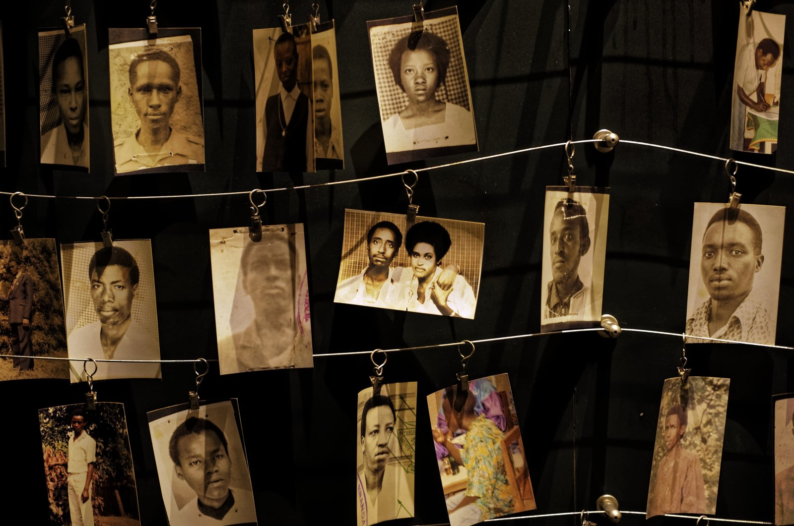 Family photographs of some of those who died in the 1994 Rwandan genocide hang on display in an exhibition at the Kigali Genocide Memorial center in the capital Kigali, Rwanda, April 5, 2019. (AP Photo)